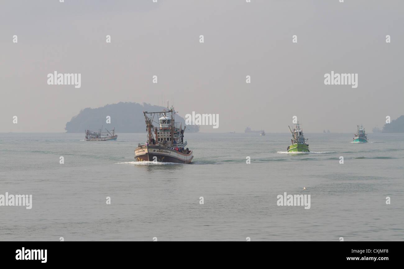 3 Fishing boats homebound. - Stock Image