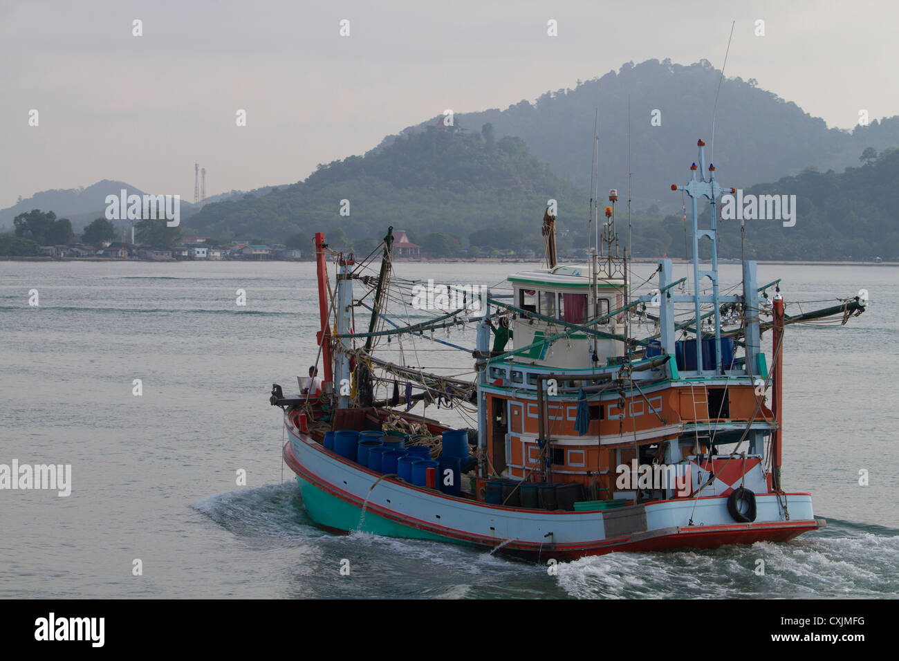 Fishing Boat returning to the Port - Stock Image