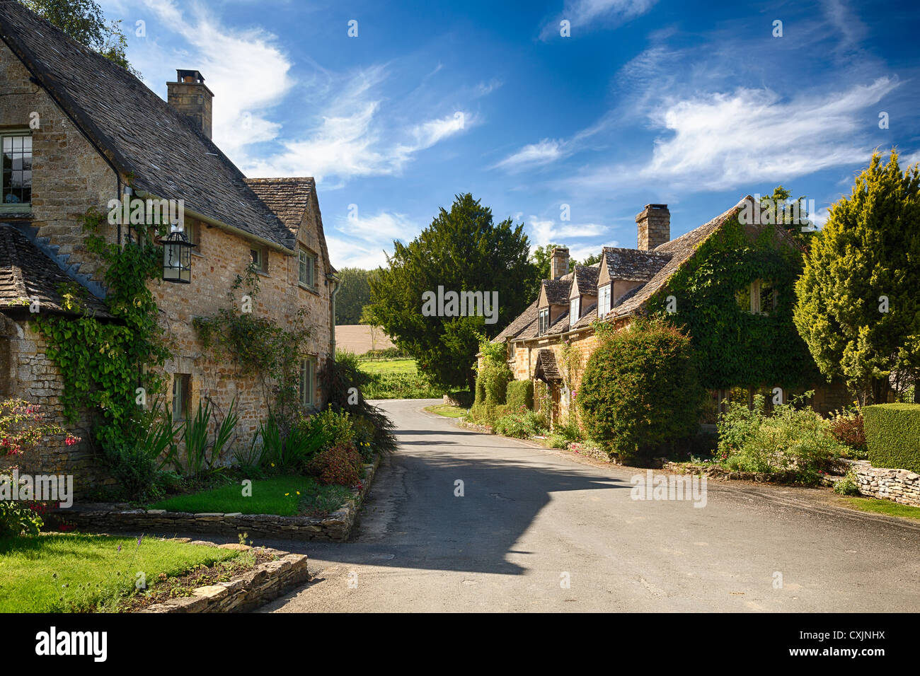 Beautiful old cotswolds stone houses in the pretty old village of Icomb, Gloucestershire, England, UK Stock Photo