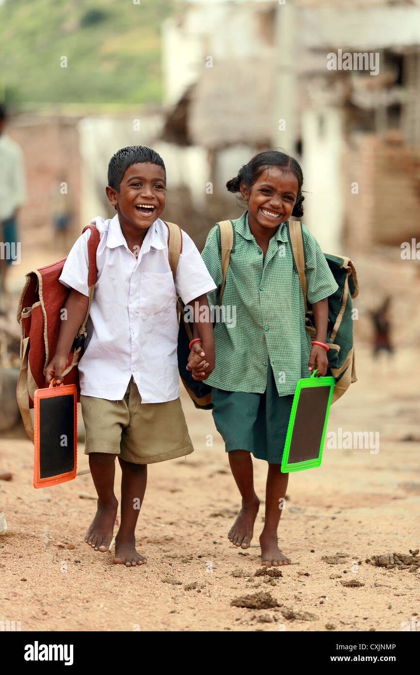 Indian school children going to school Andhra Pradesh South India - Stock Image
