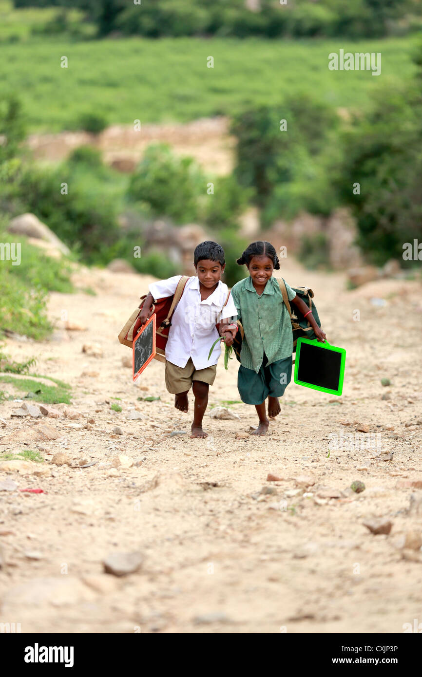 Indian school children running to go to school Andhra Pradesh South India - Stock Image