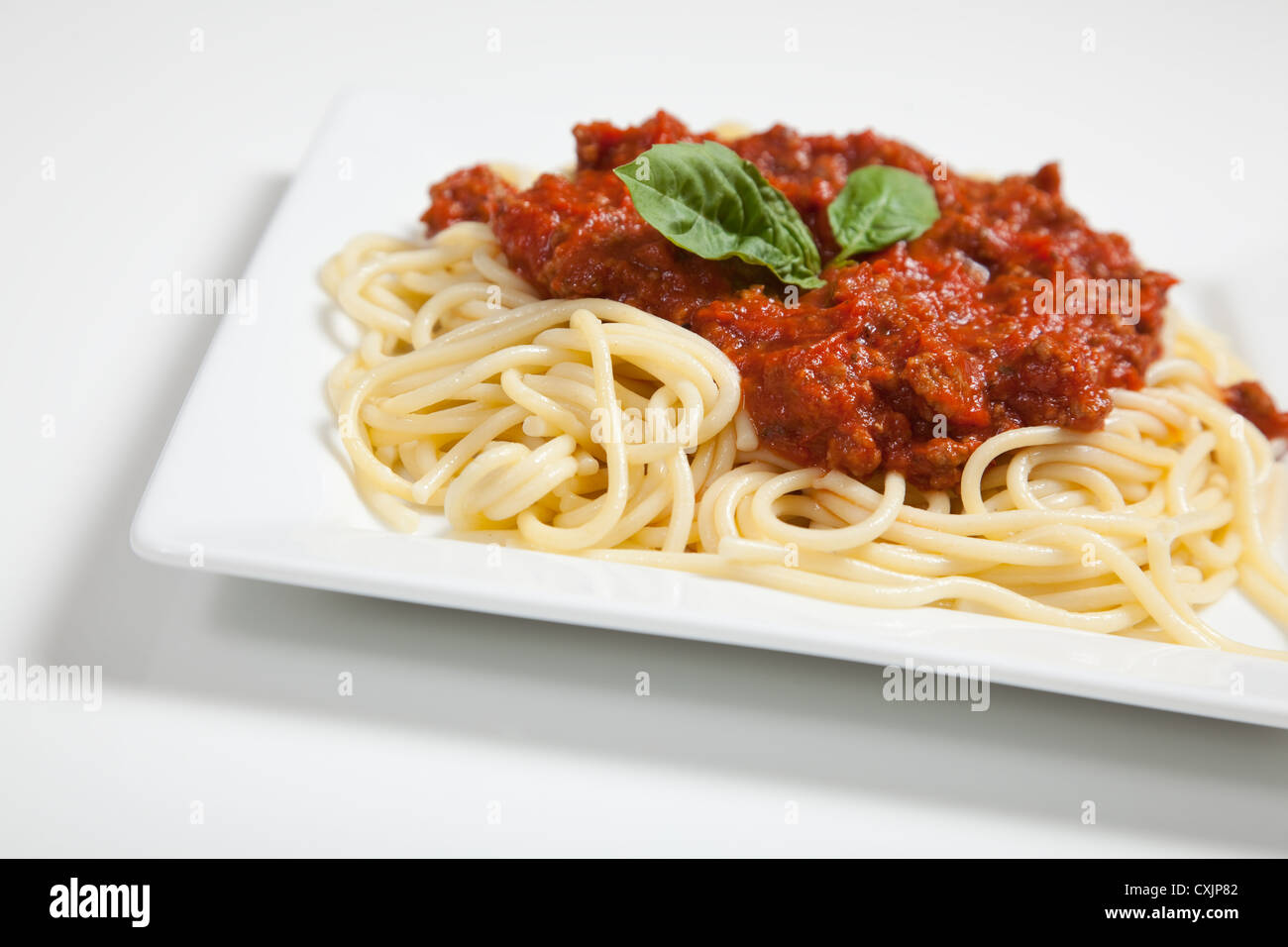 Spaghetti with meat sauce on a white background - Stock Image