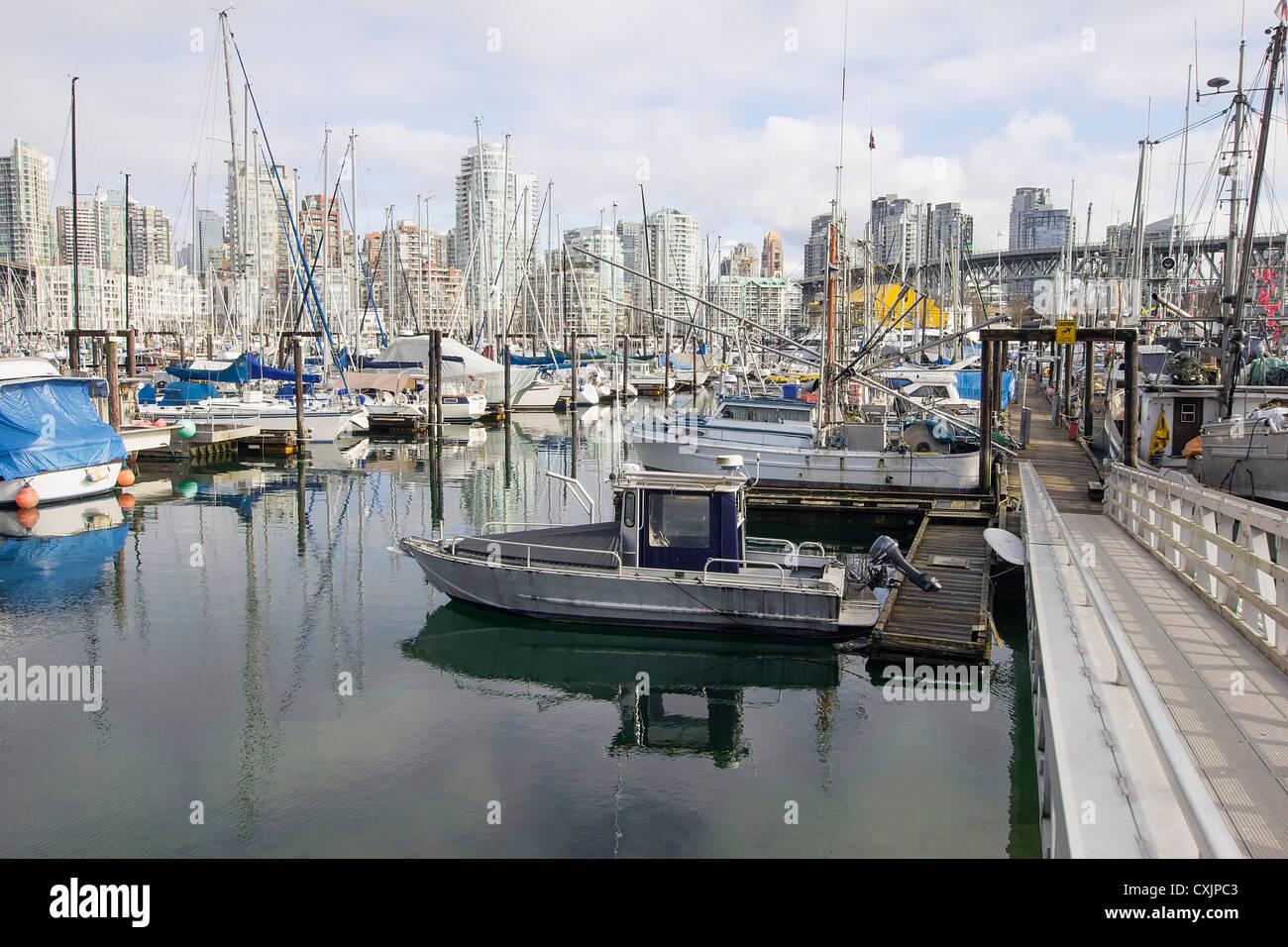 Boats Moorage in Harbor under Granville Island Bridge in Vancouver BC Canada - Stock Image