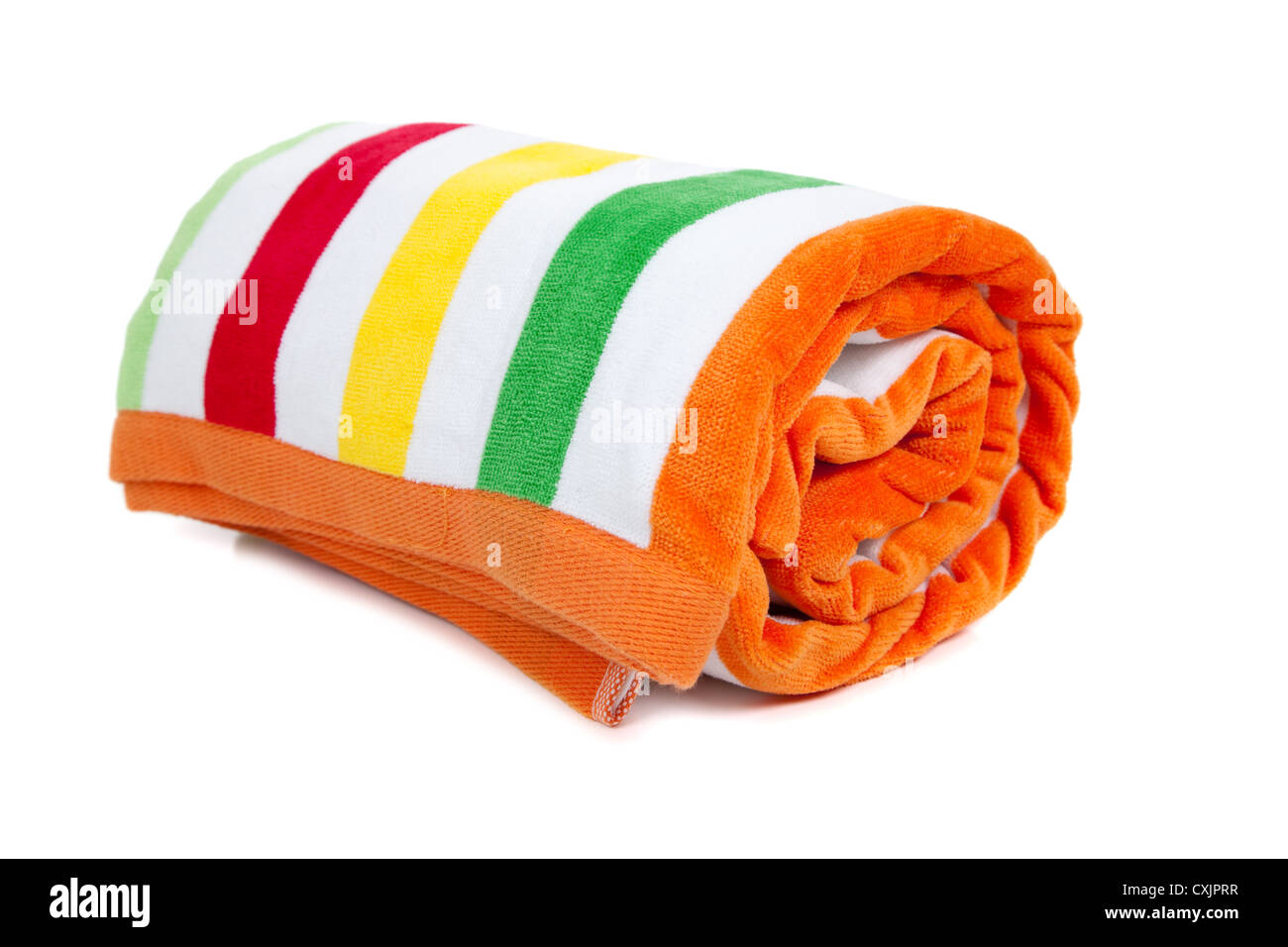 Brightly colored rolled beach towel on a white background - Stock Image