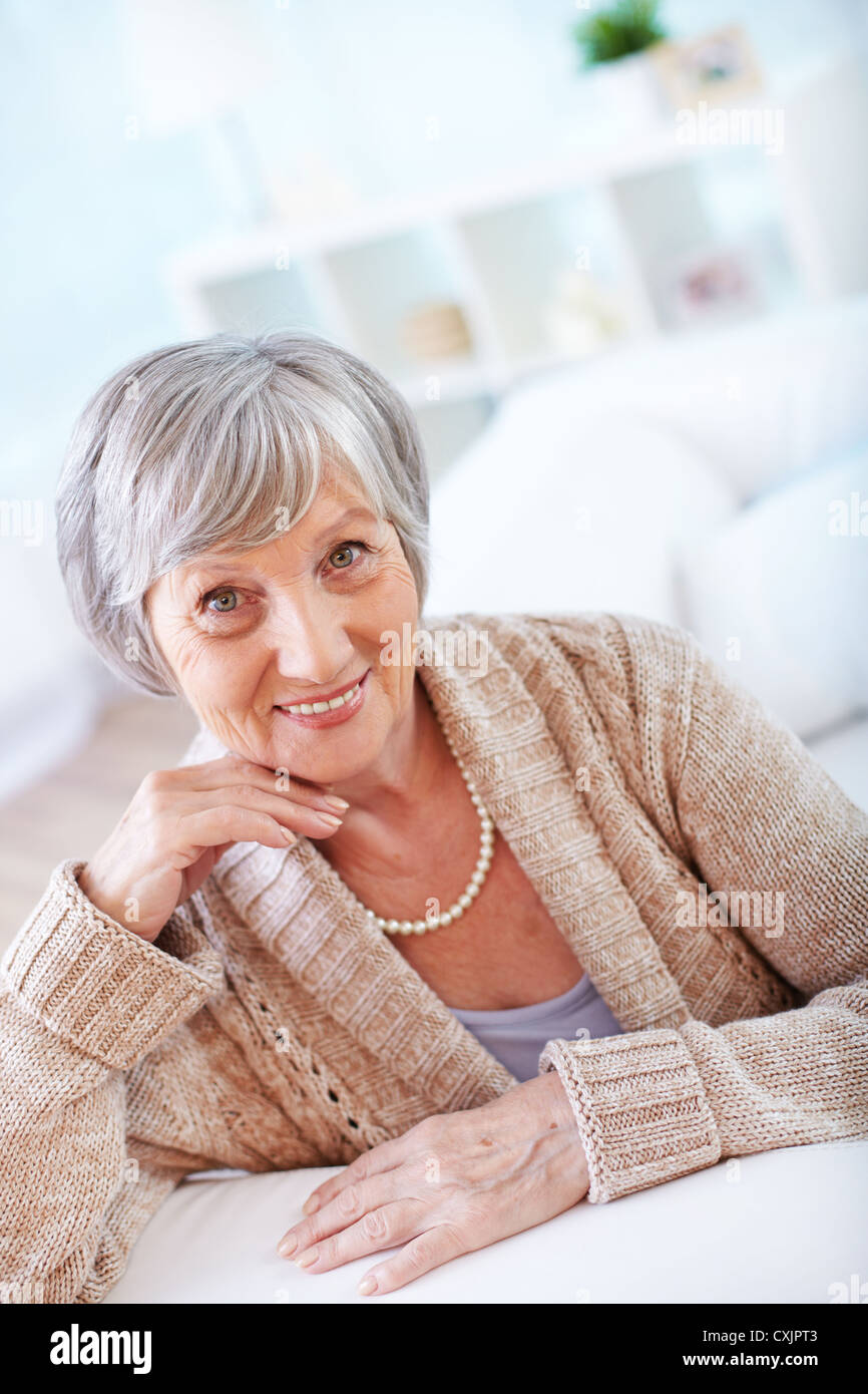 Portrait of aged female looking at camera - Stock Image