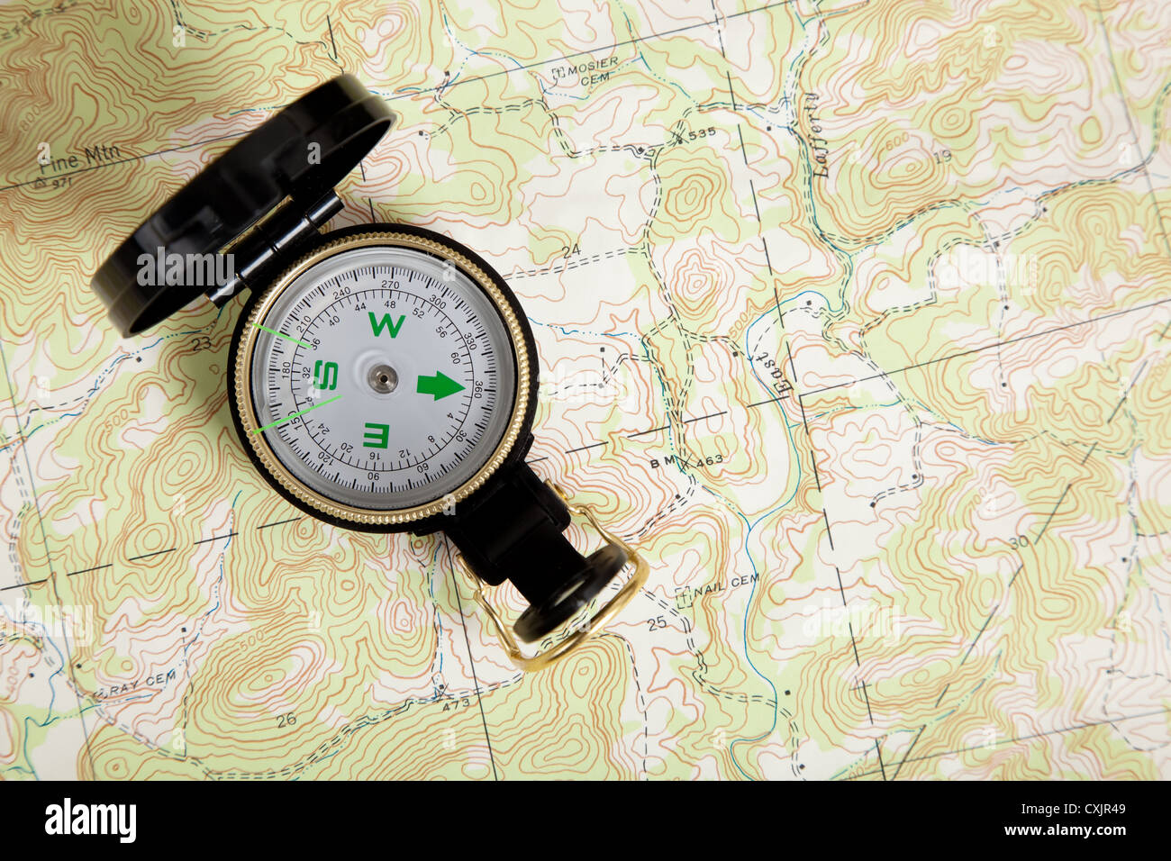 Topographical map and compass - Stock Image