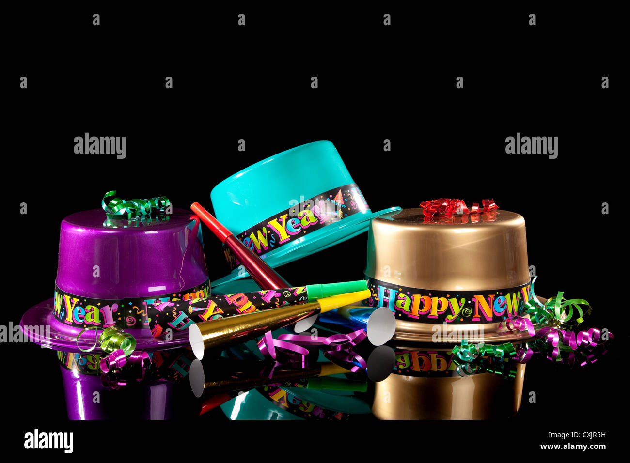 new years eve party hats and decorations on a black background