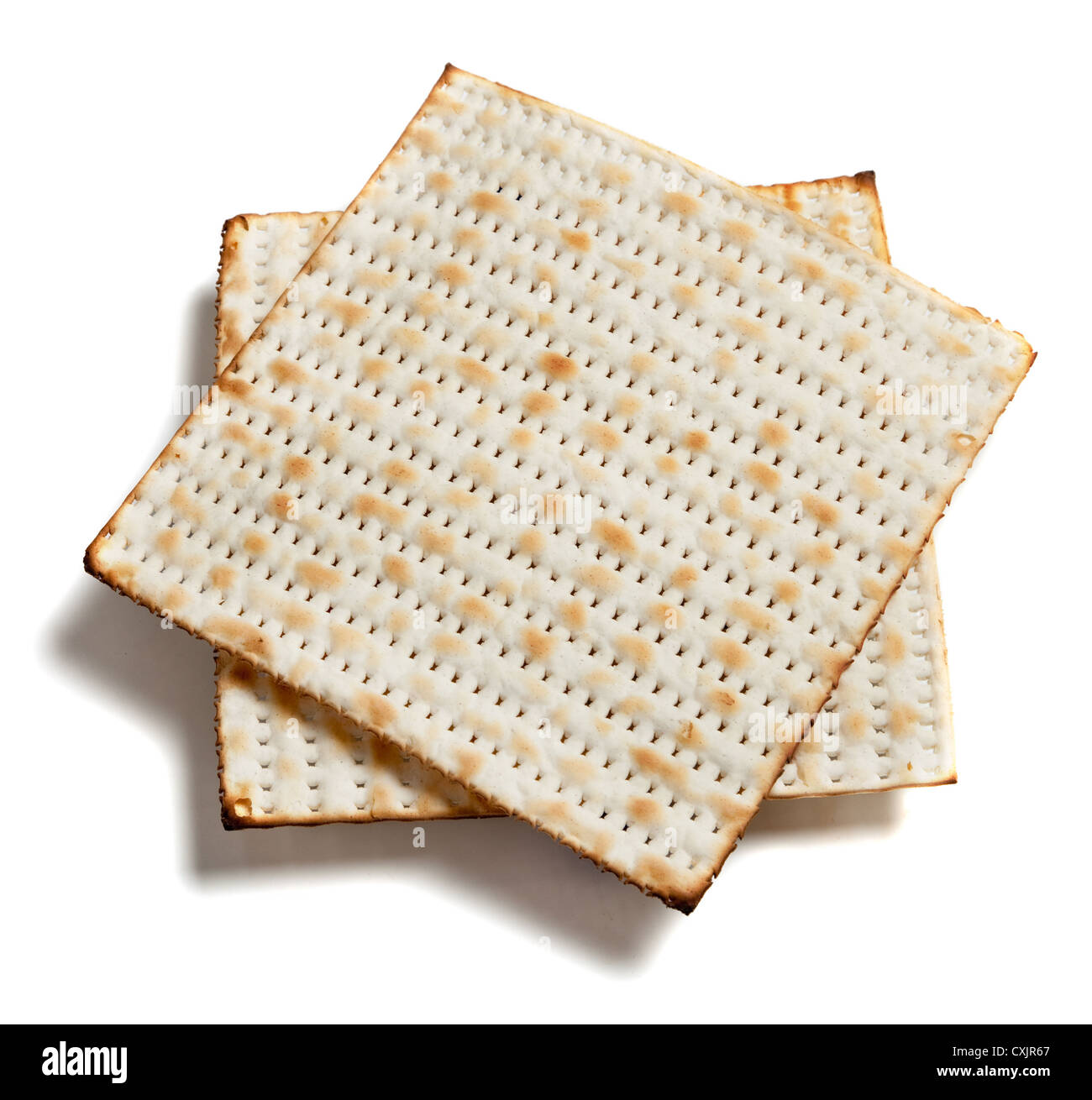 Stack of Matzo bread on a white background - Stock Image