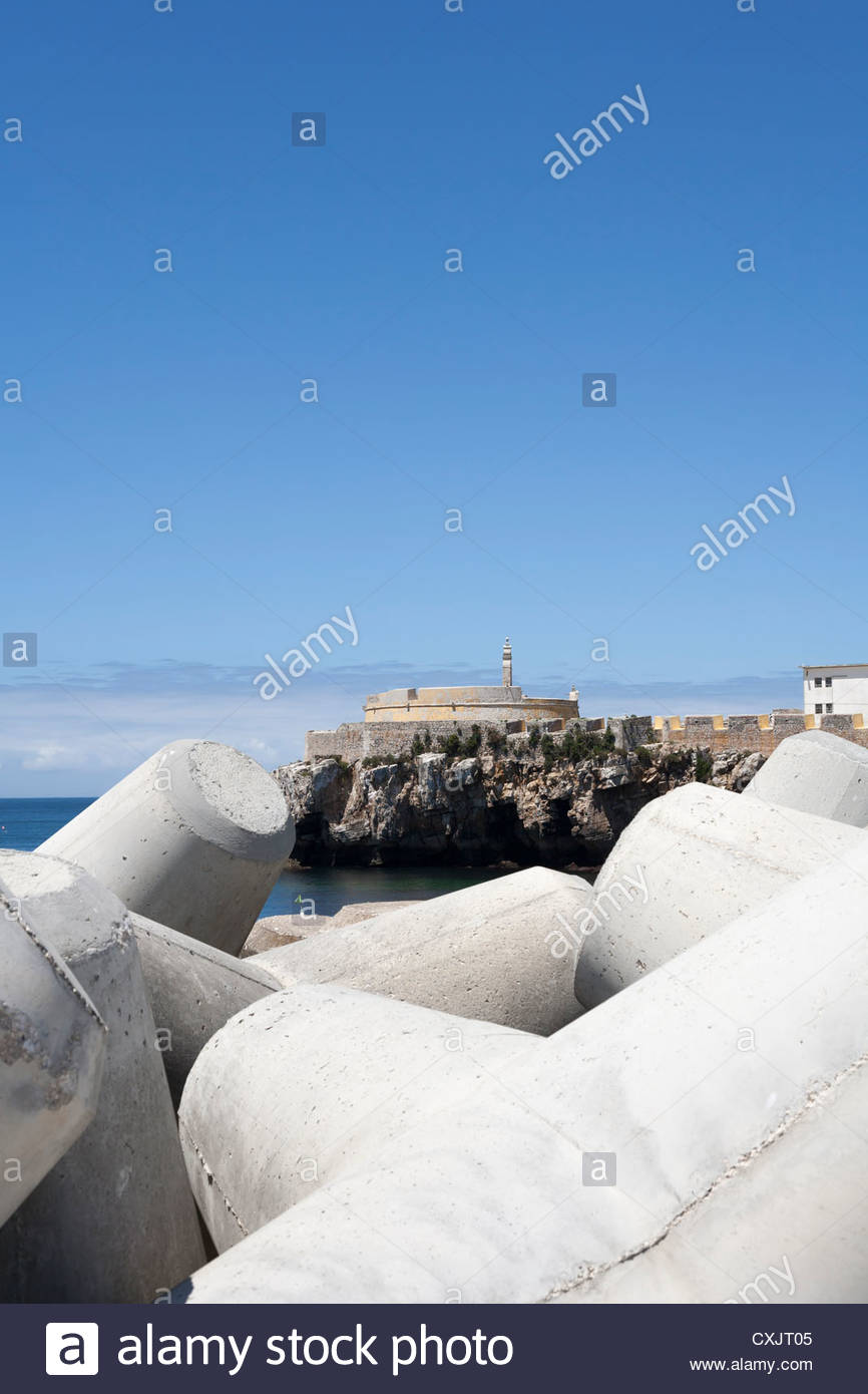 Concrete tetrapod beach defense in Peniche, Portugal. - Stock Image