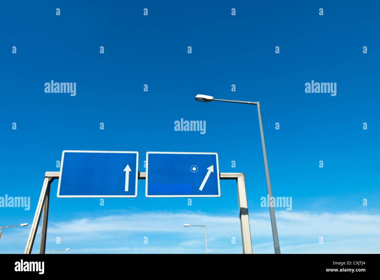 cleared road sign above motorway exit - Stock Image