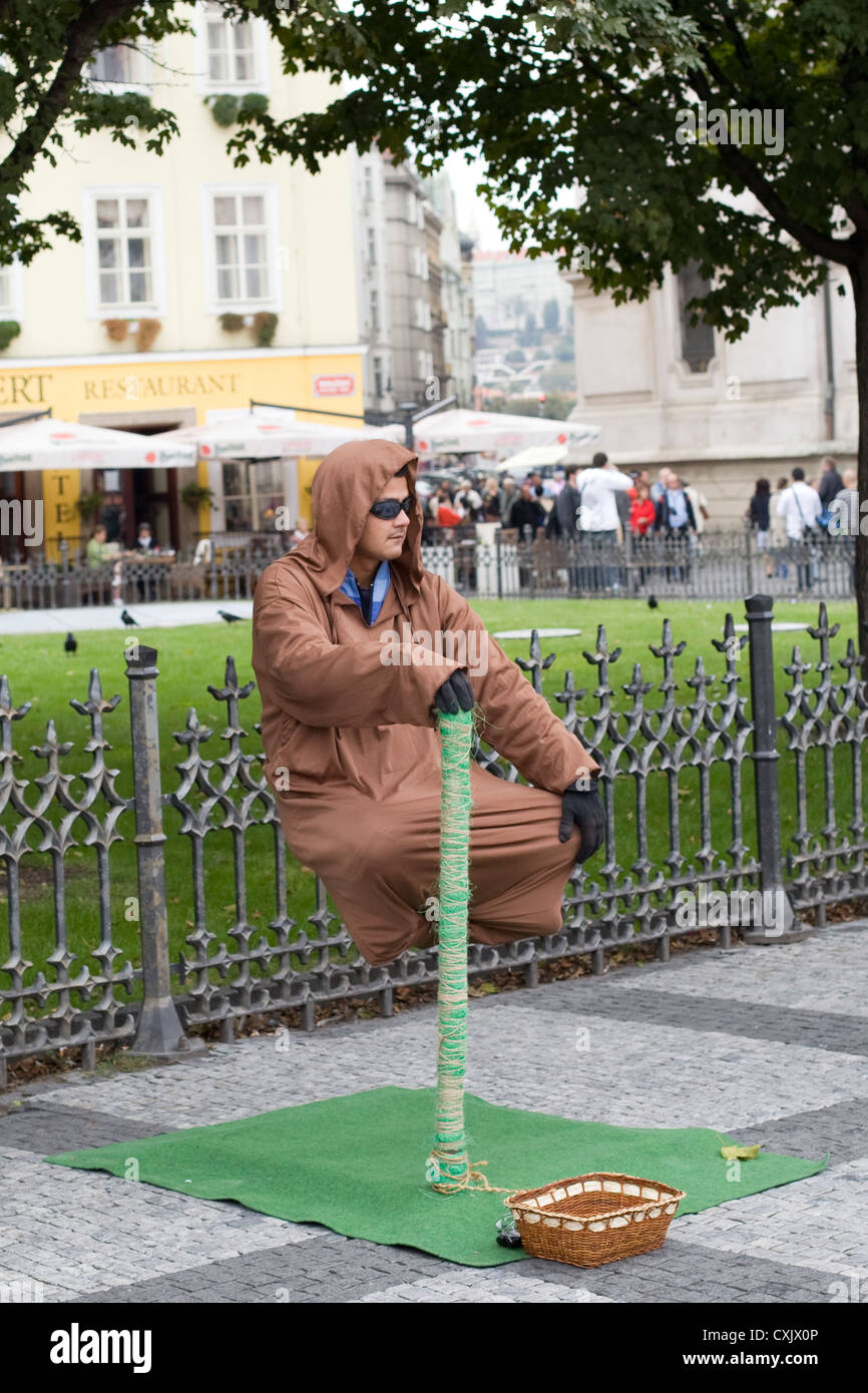 Street Performer on the streets of Prague Yoda - Stock Image