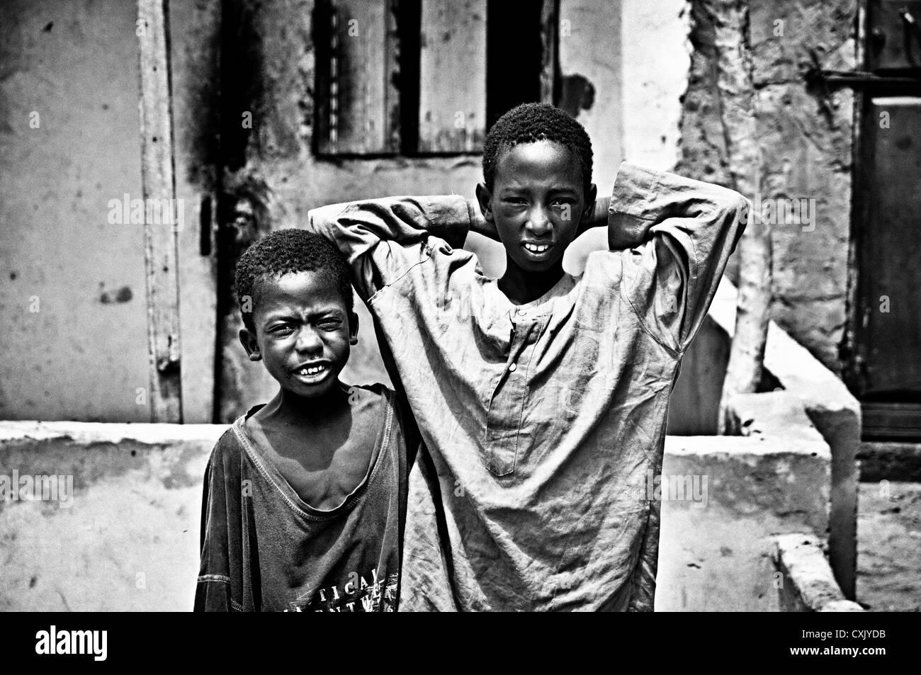Portrait of two children in Saint Louis streets. Saint Louis, Senegal - Stock Image