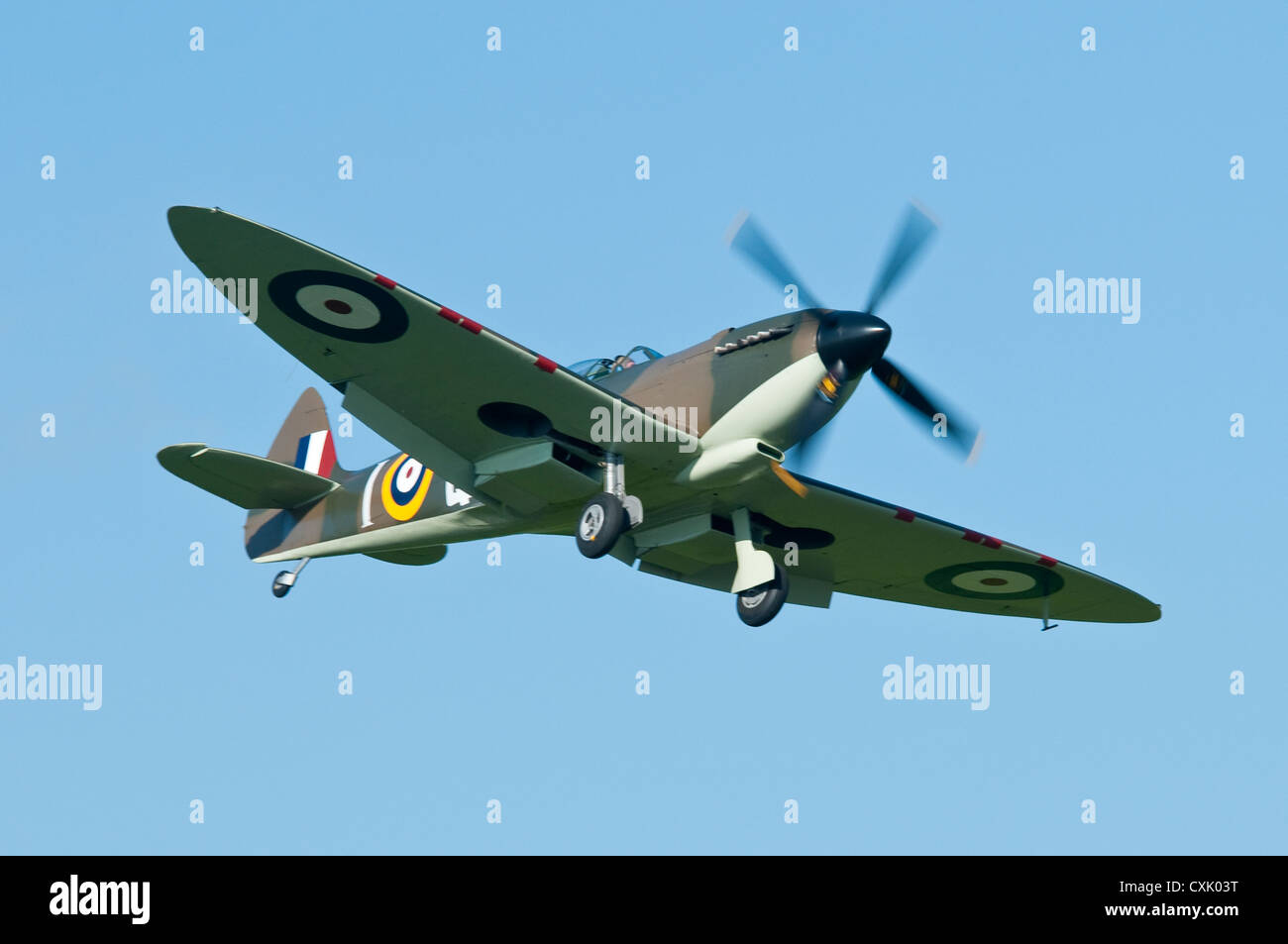 Spitfire with Undercarriage Down Coming Into Land - Stock Image