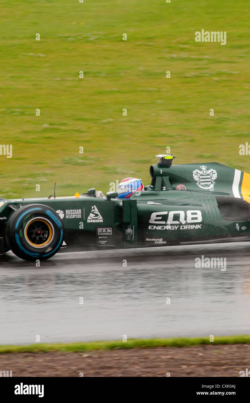 Vitaly Petrov in his Caterham F1 Car in the Wet - Stock Image