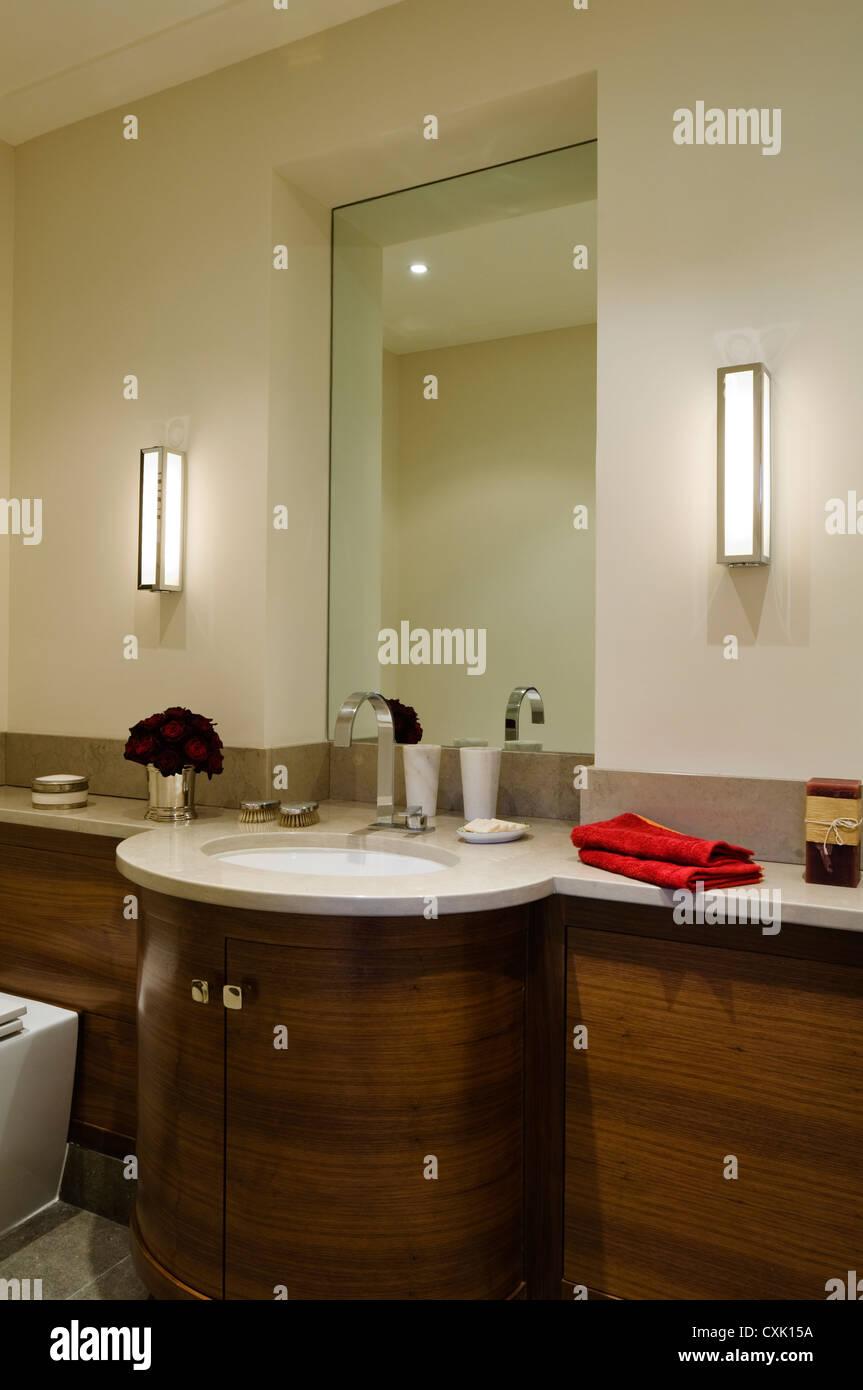 Colour Interior Bathroom Mirror Washbasin Tap Fitting Reflection Cupboard Wood Grain Flower Arrangement Lit Light Folded Towel