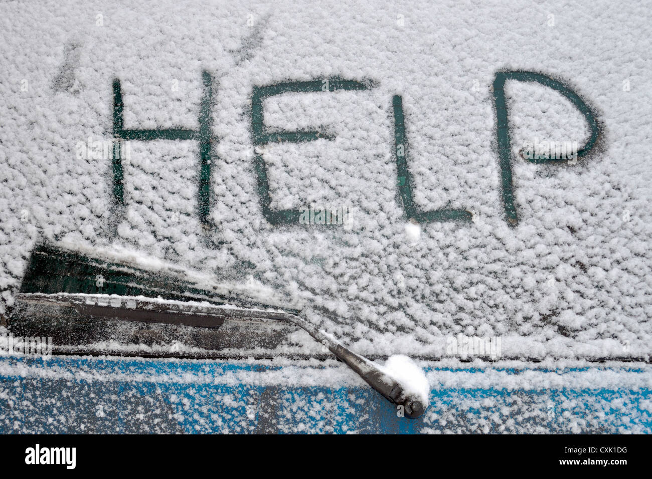 Help word written on rear car window covered by heavy snowfall - Stock Image