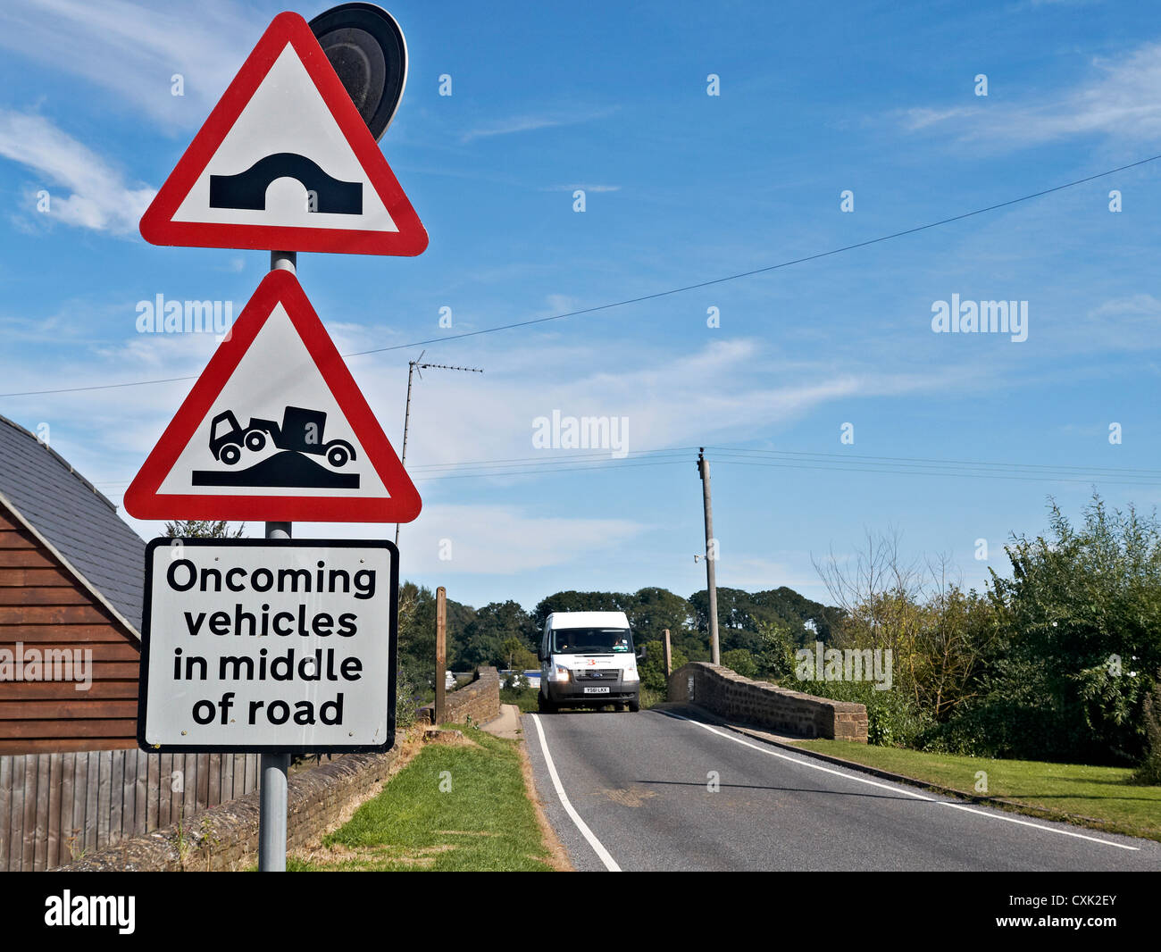 UK road sign warning of the danger of oncoming vehicles in the middle of the road. Oxfordshire England Europe - Stock Image