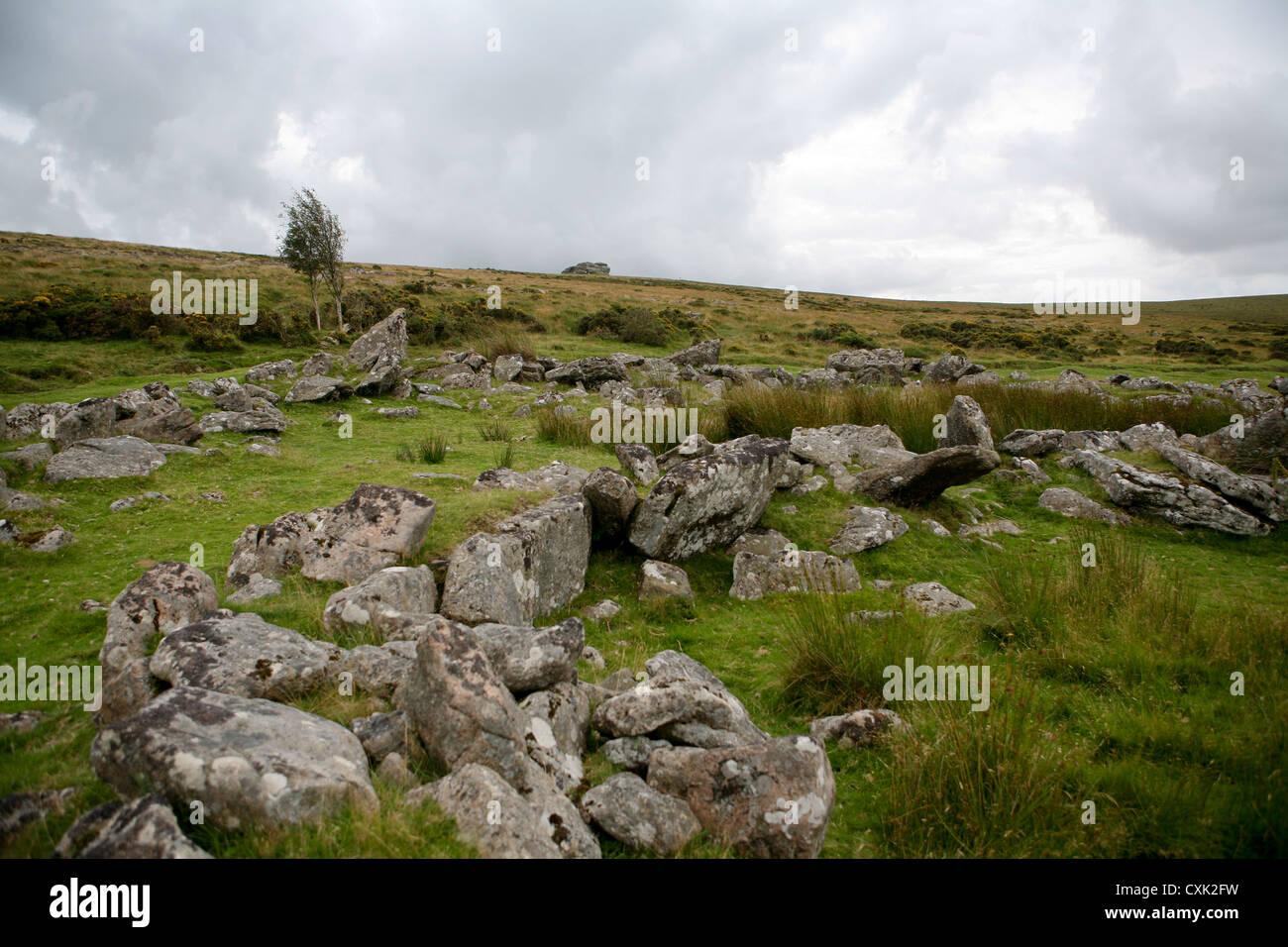 Large ancient hut circle, granite stone walls, with Kestor Rock on the horizon, Dartmoor National Park, Devon, UK - Stock Image