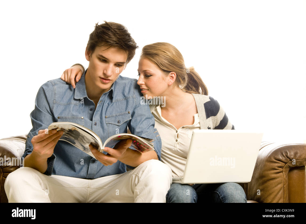 couple with laptop and journal - Stock Image