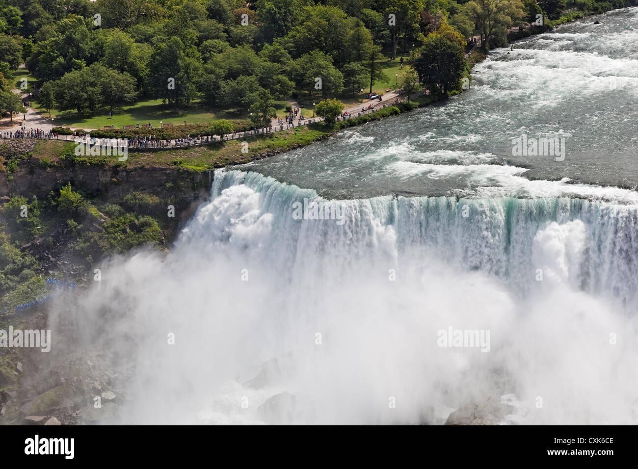 Visitors at the American Falls at Niagara Falls. - Stock Image
