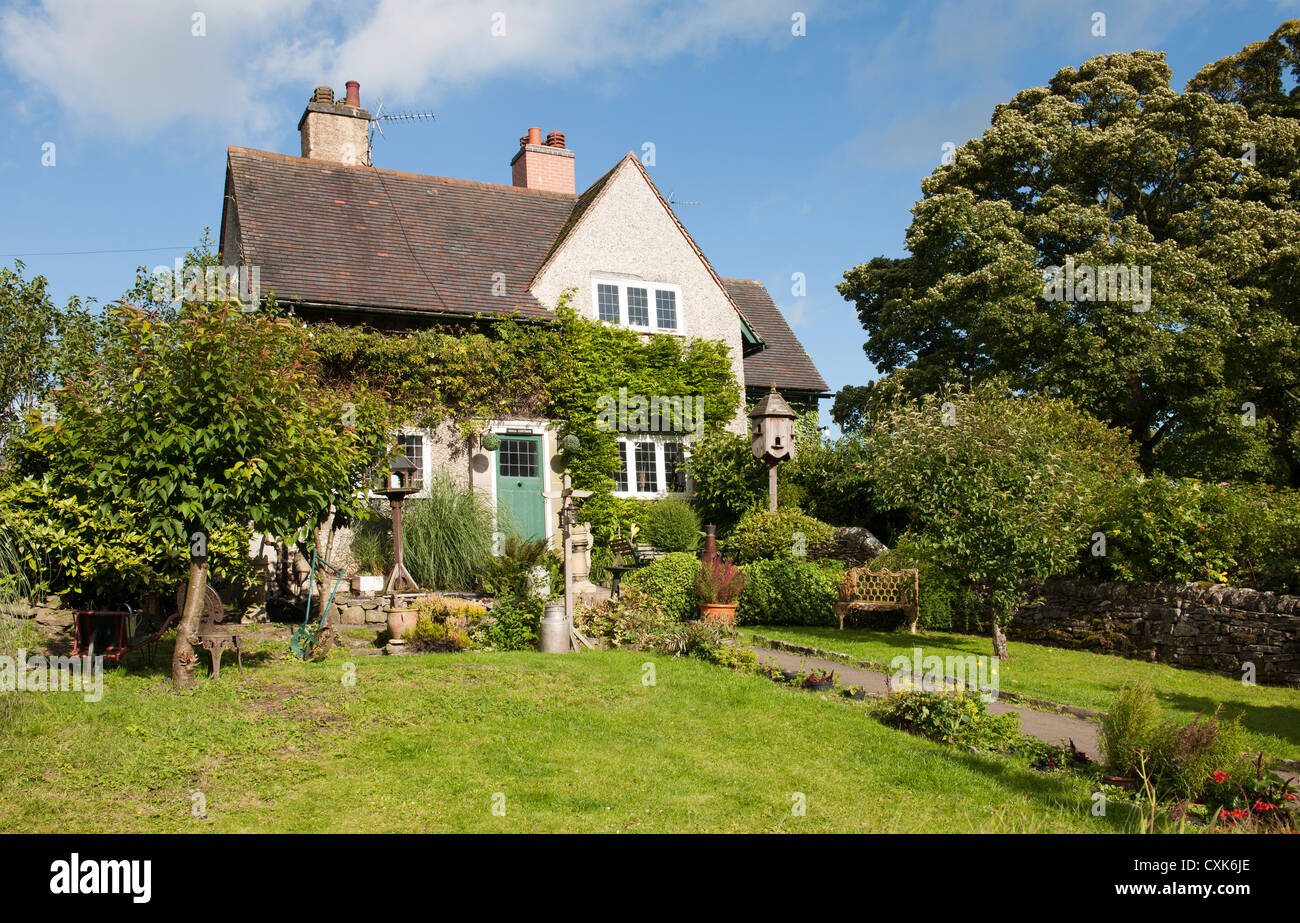 Cottage in the village of Tissington, Derbyshire, England, Uk. - Stock Image