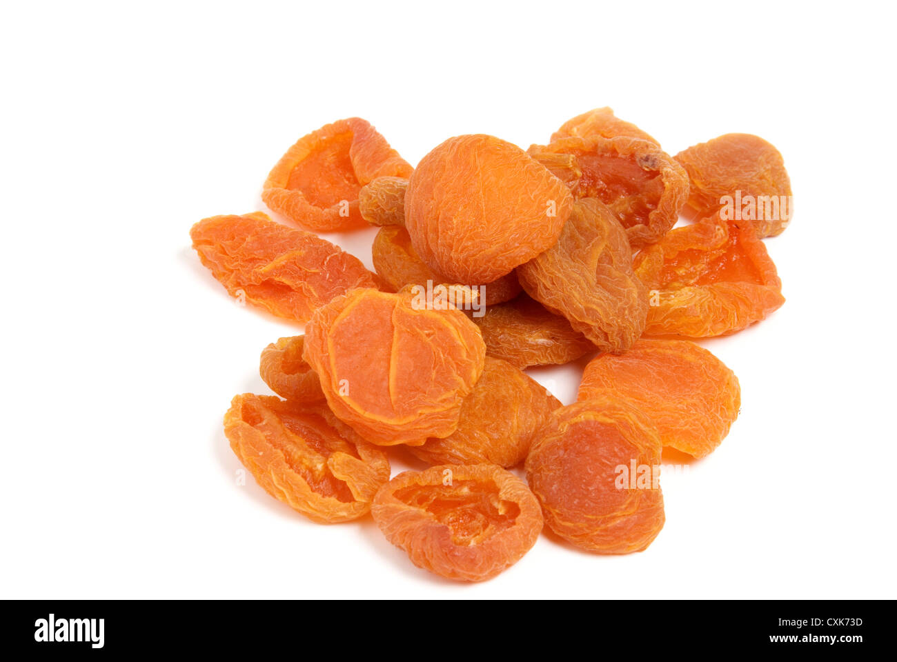 Dried Apricots on white background. - Stock Image