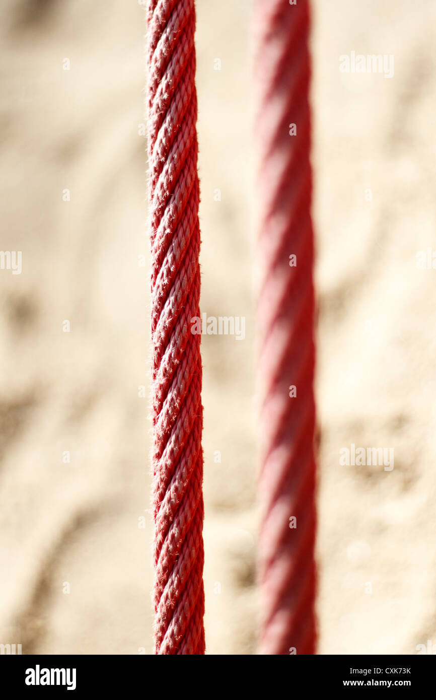 Detail of red rope, France. - Stock Image