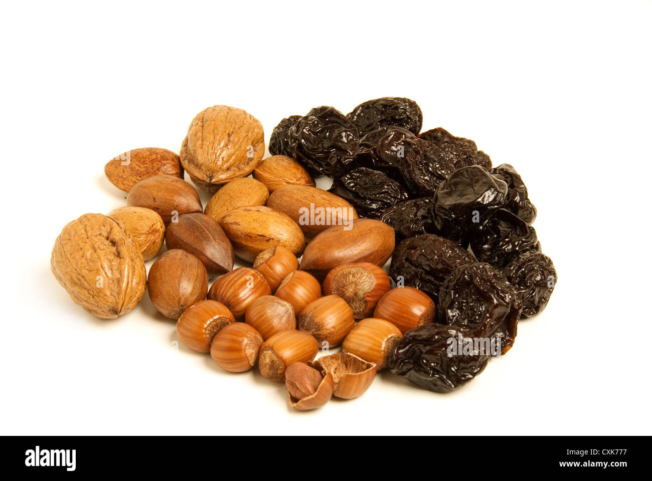 Dried prunes and nuts isolated, healthy food concept. - Stock Image