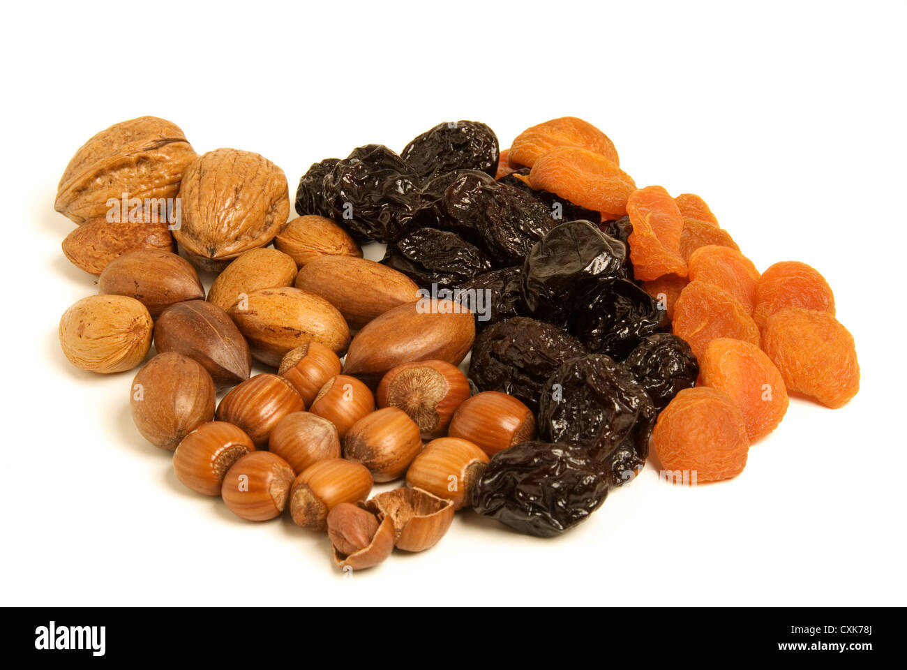 Dried fruit and nuts - Prunes, Apricots, Hazelnuts, pecans and walnuts isolated. - Stock Image