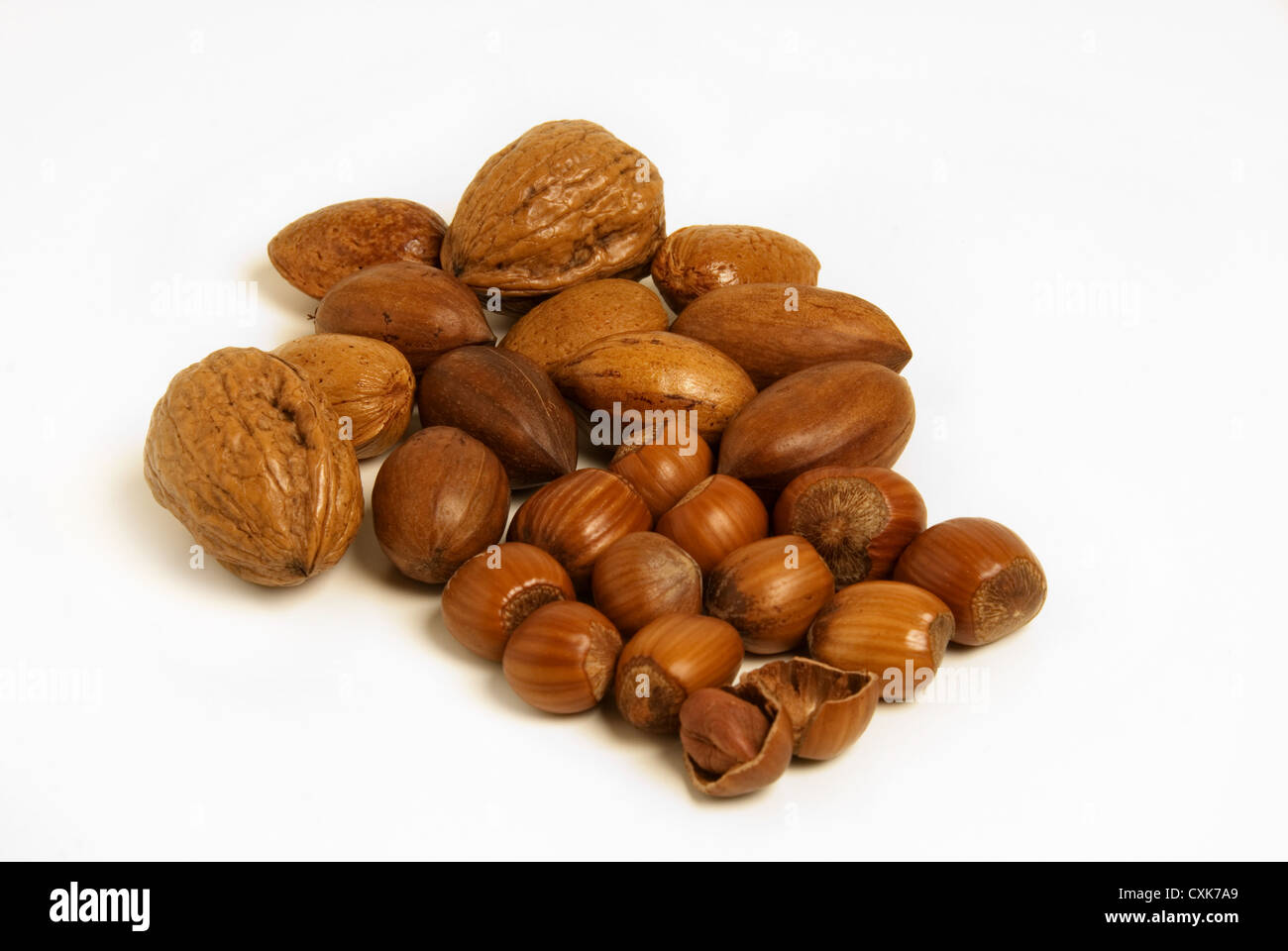 A mix of nuts - Walnuts, hazel and pecan nuts on white background. - Stock Image