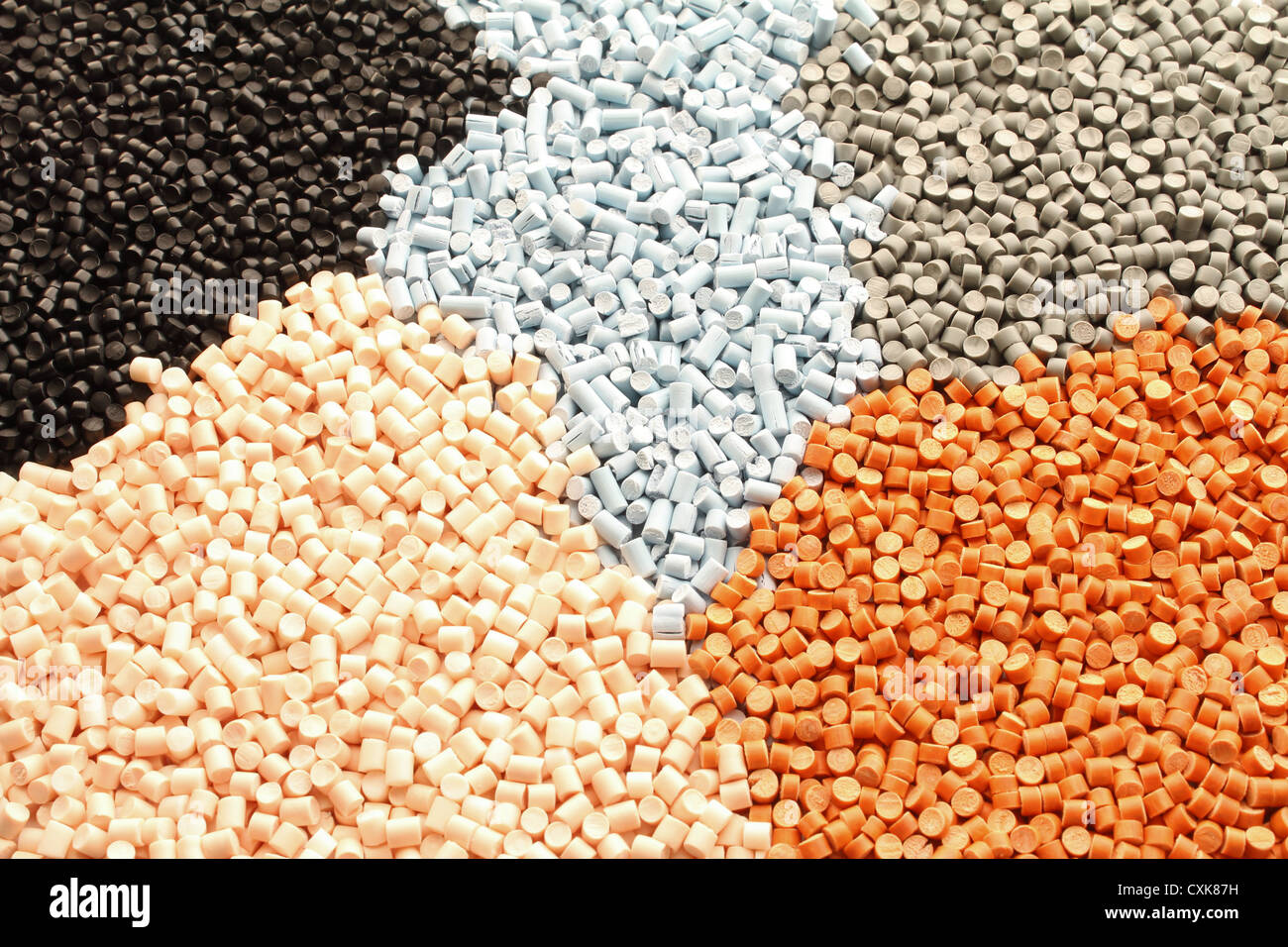 Colored plastic granules for extrusion work. Stock Photo