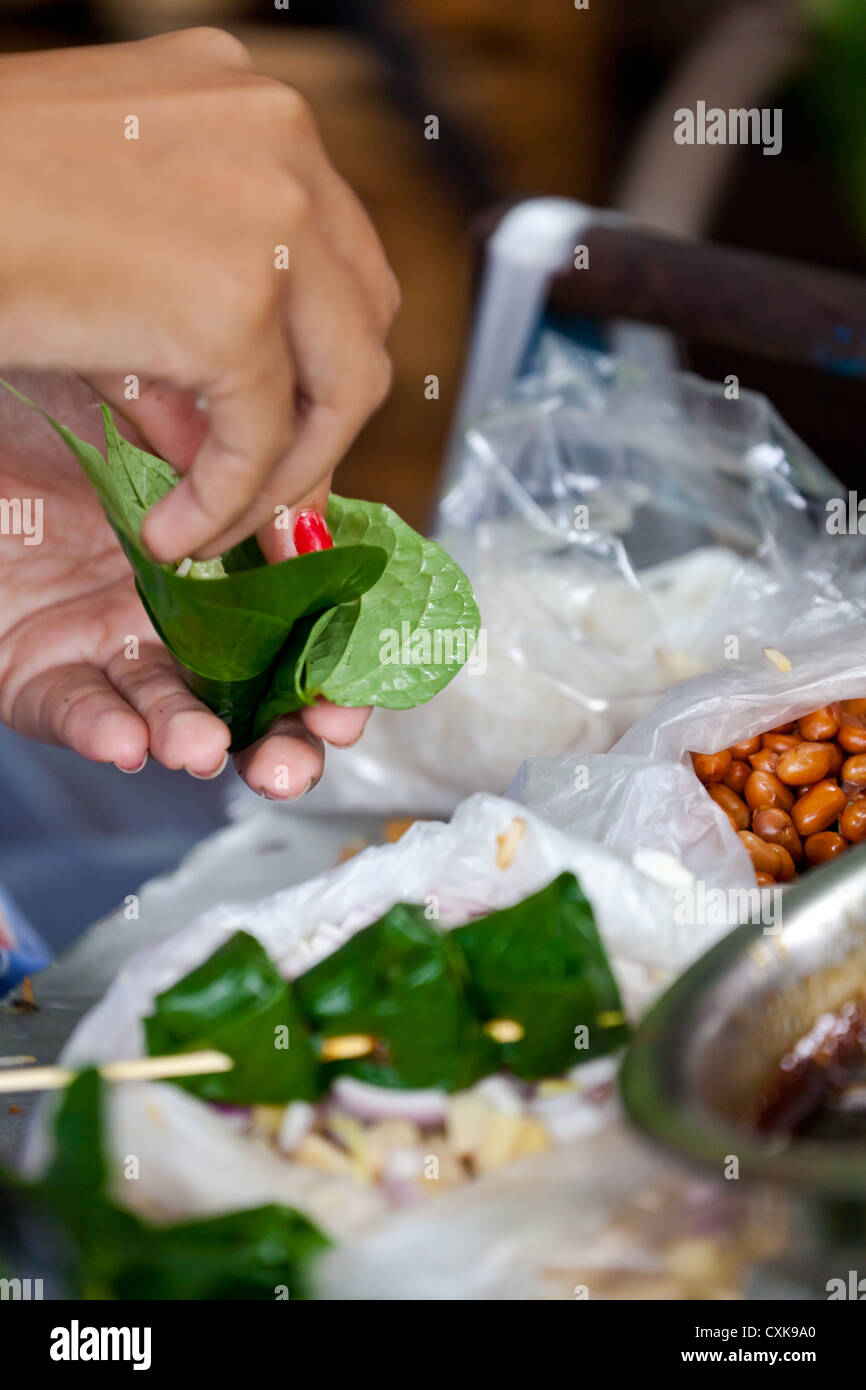 Filling Leafs on the Chatuchak Market in Bangkok - Stock Image