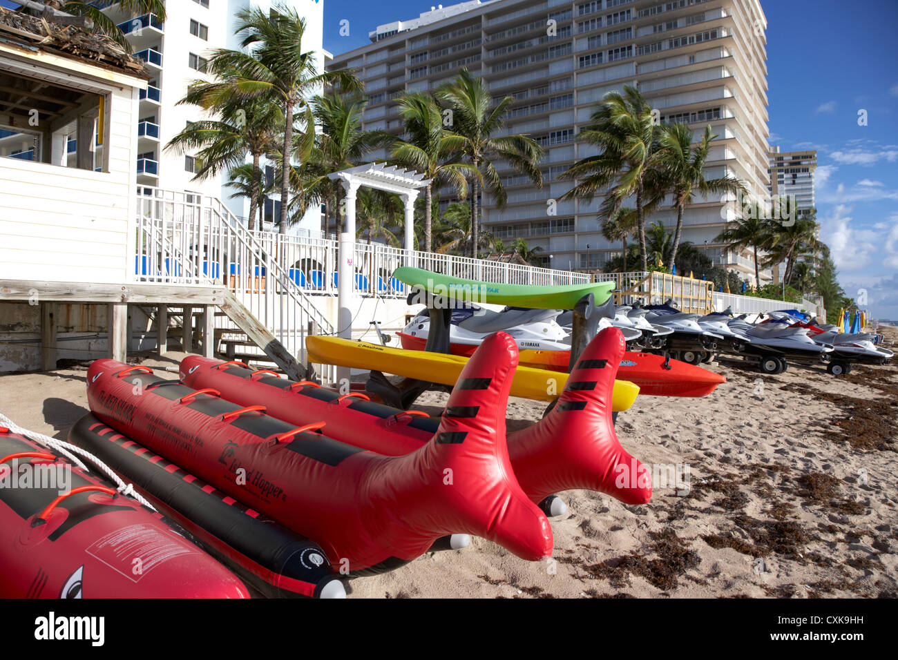 watersports equipment for hire in front of apartments hotels and beachfront developments fort lauderdale beach florida - Stock Image