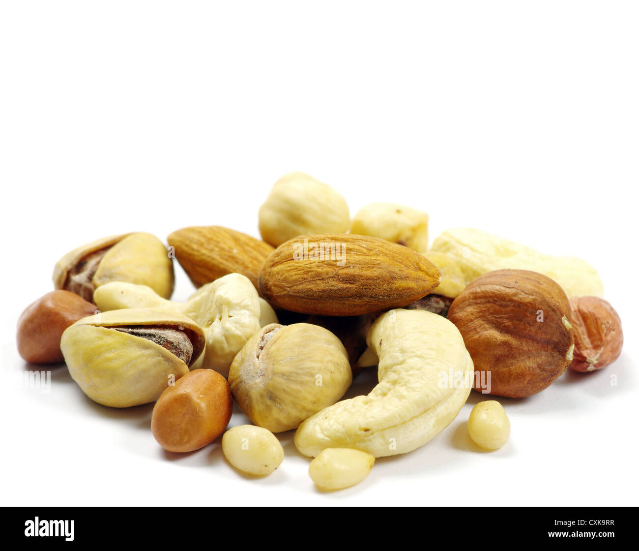 Assorted mixed nuts on white background - Stock Image