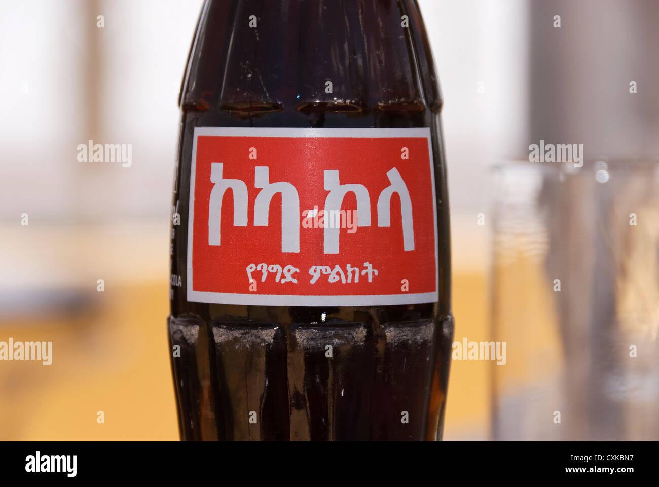 Elk200-1176 Ethiopia, Addis Ababa, Coca Cola bottle with Amharic script - Stock Image
