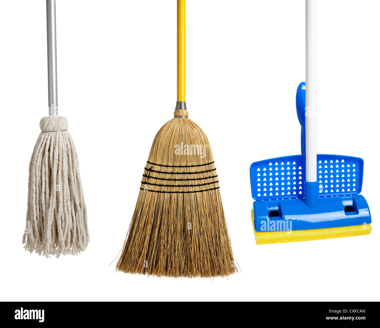 row of String mop, sponge mop and a straw broom - Stock Image