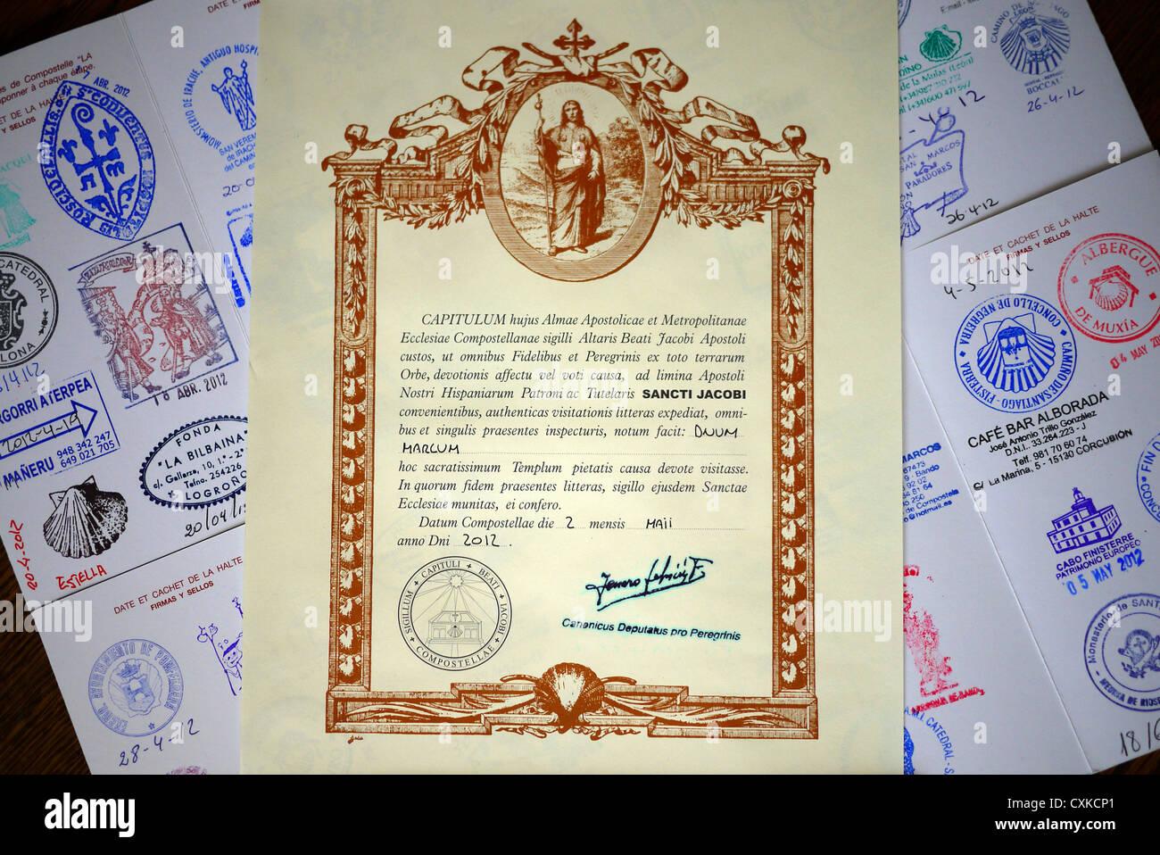 Santiago de Compostela Pilgrims passport and Compostela. - Stock Image