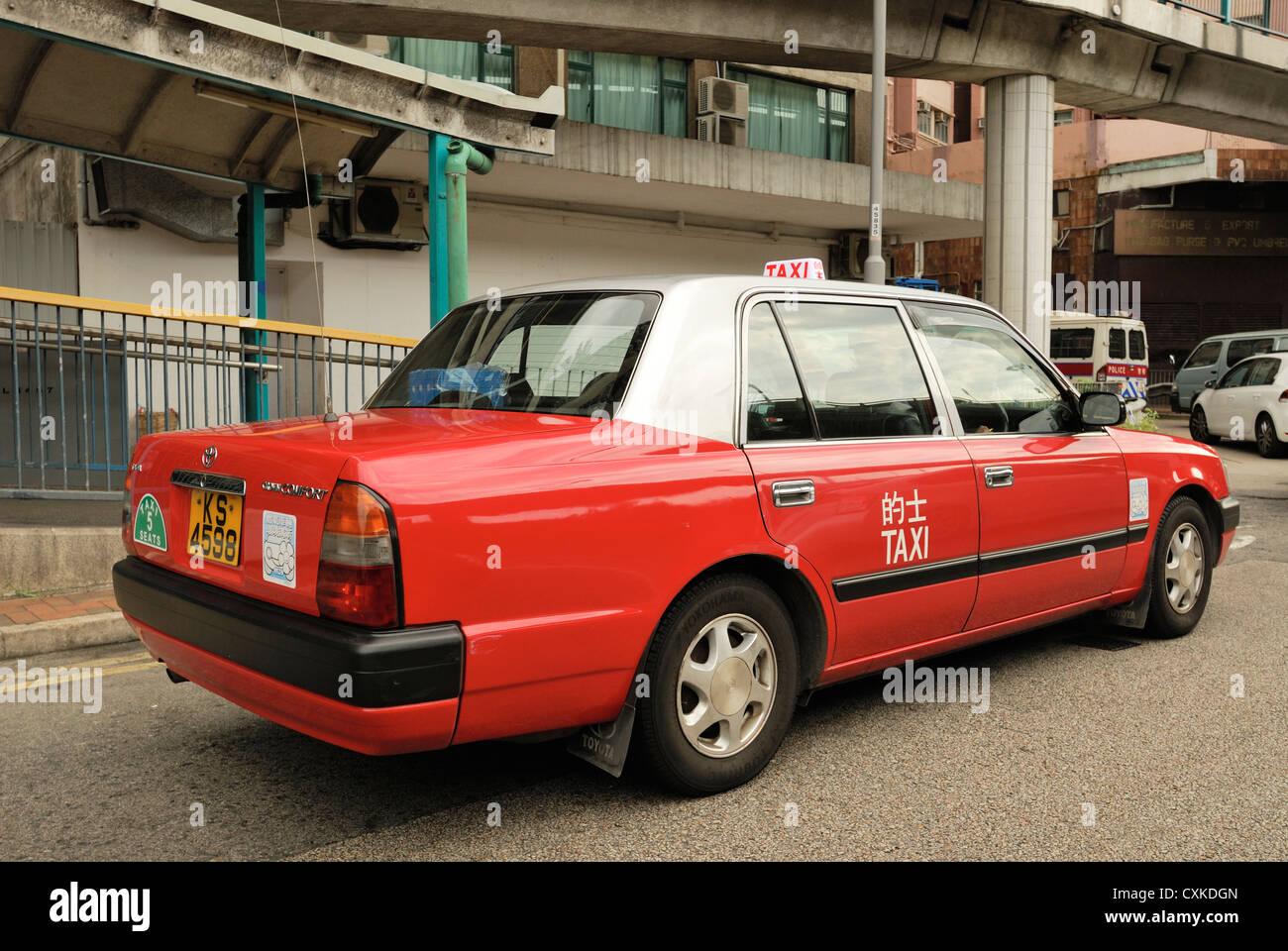 Red Hong Kong taxi HKSAR. - Stock Image