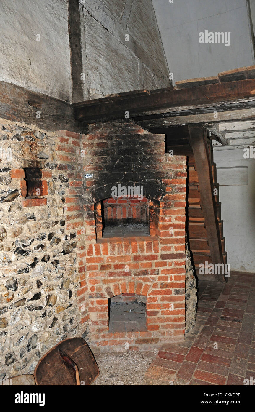 Bakehouse and bread oven in the 17th century cottage from Walderton. Weald and Downland Open Air Museum. - Stock Image