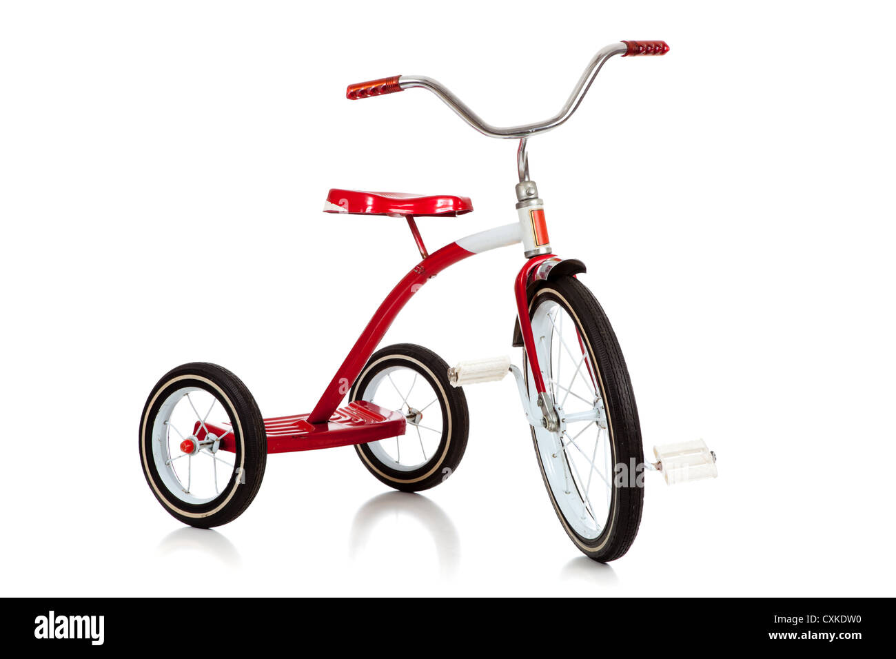 Red tricycle on a white background - Stock Image