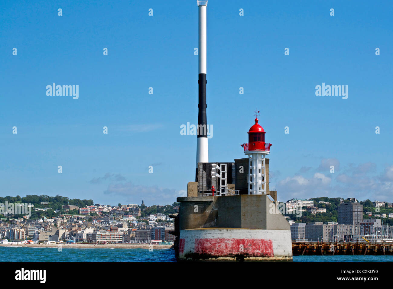 Lighthouse in red and white with a blue sky - Stock Image