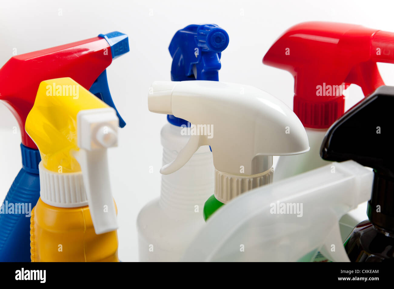Cleaning spray bottle with multicolored nozzles Stock Photo