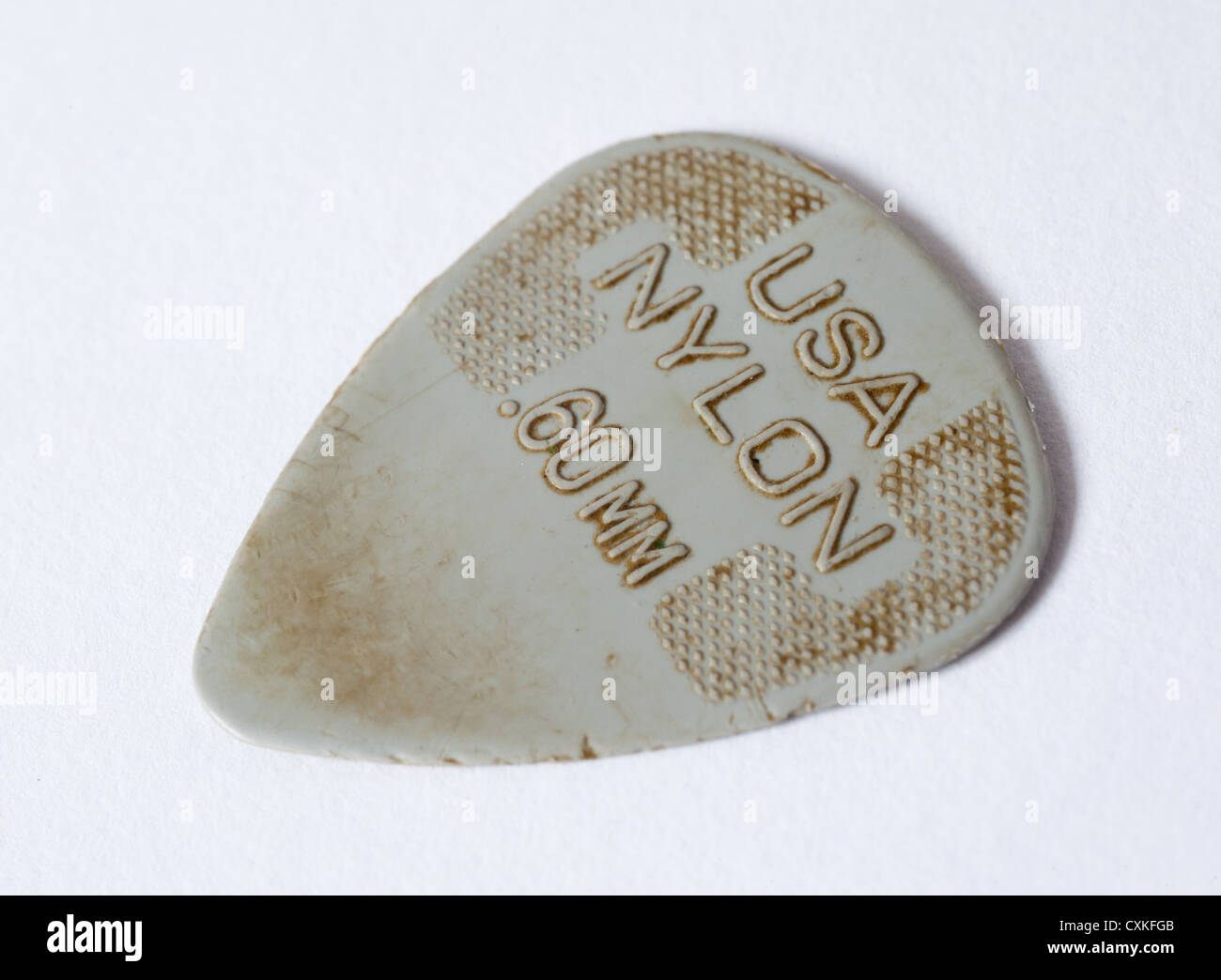 A Close Up View Of Worn Guitar Pick
