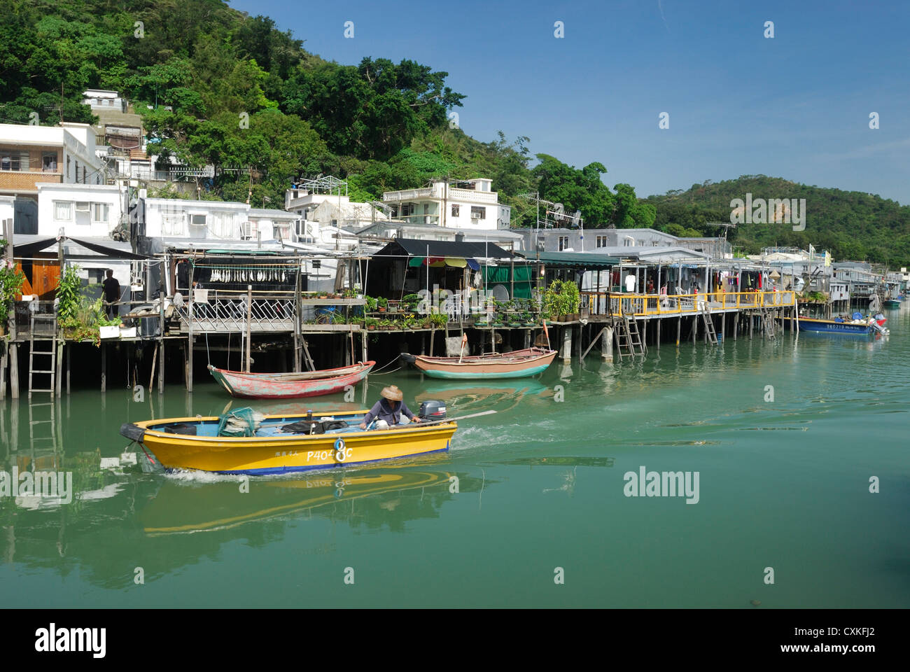Houses on stilts line the waterway of the small traditional fishing village of Tai O, located on Lantau Island, - Stock Image