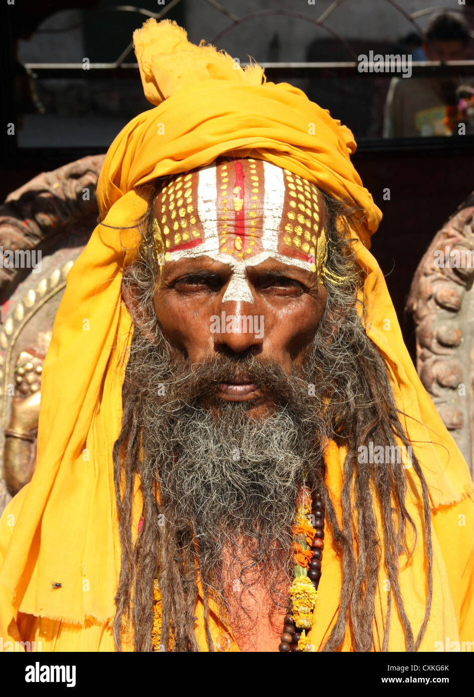 Hindu sadu holy man outside temple in Kathmandu, Nepal - Stock Image