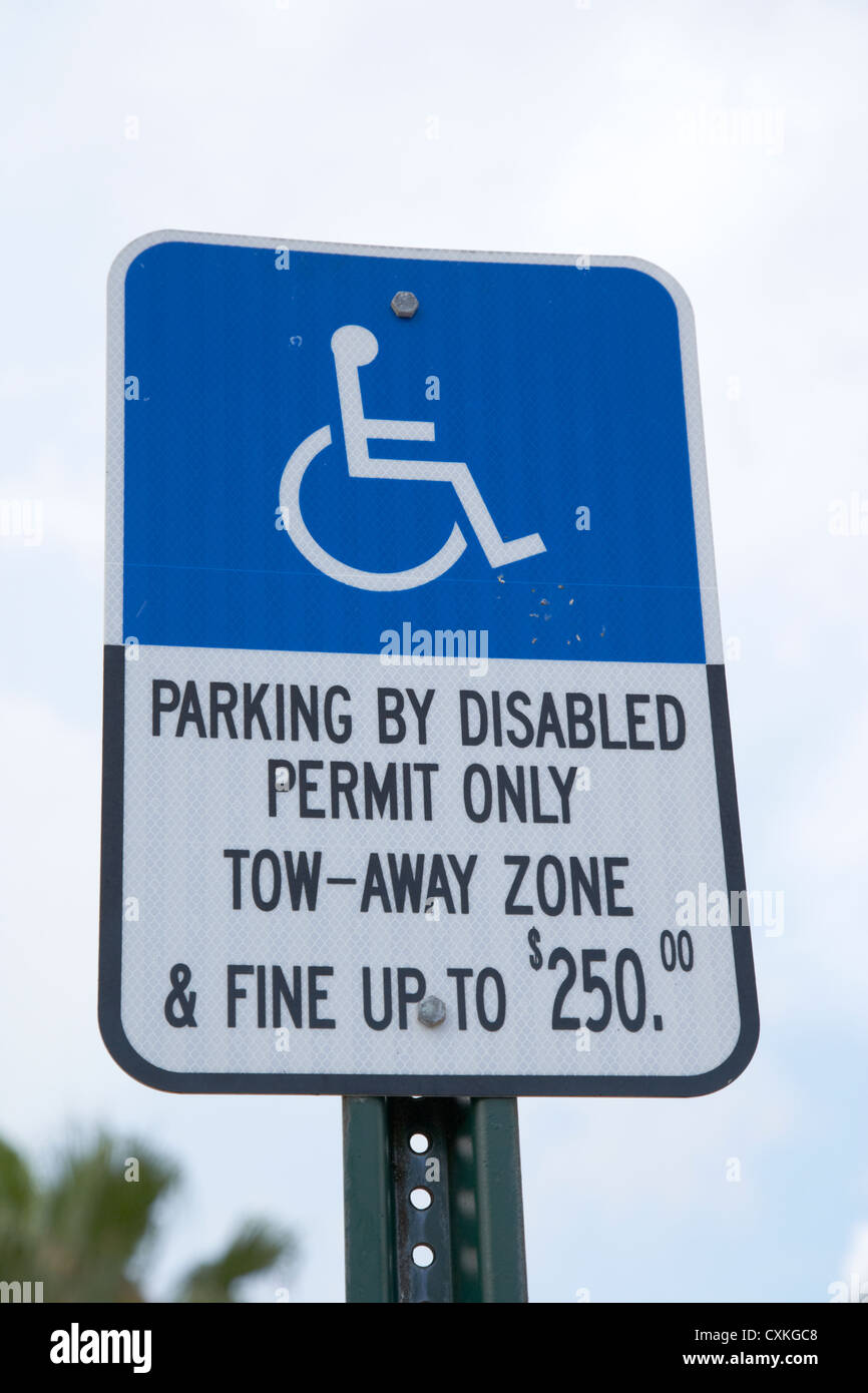 parking by disabled permit only tow-away zone fine sign miami florida usa - Stock Image