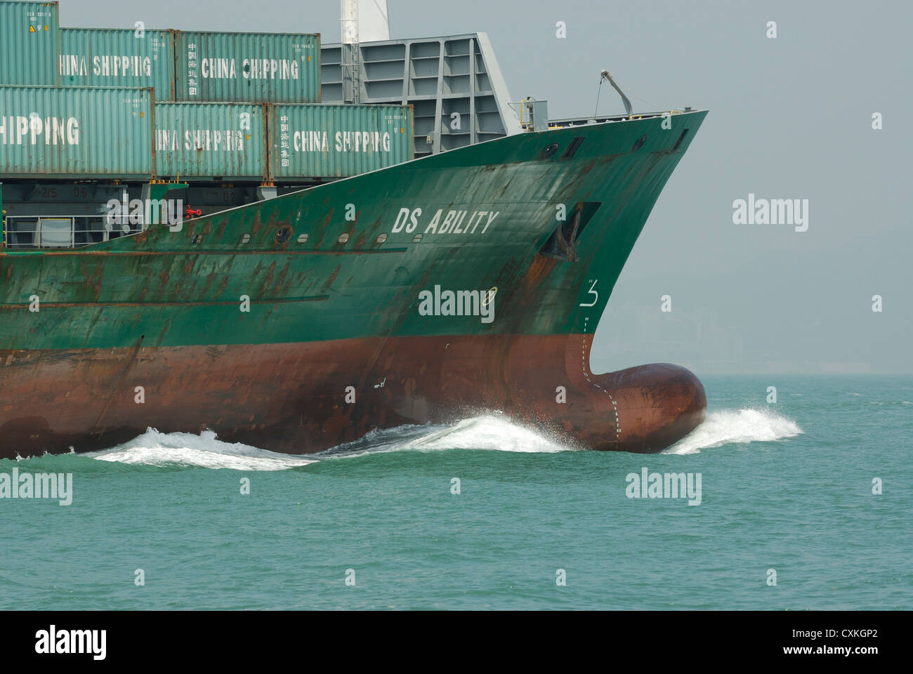 Bow of a freight moving through the waters of the South China Sea, Hong Kong, China. - Stock Image