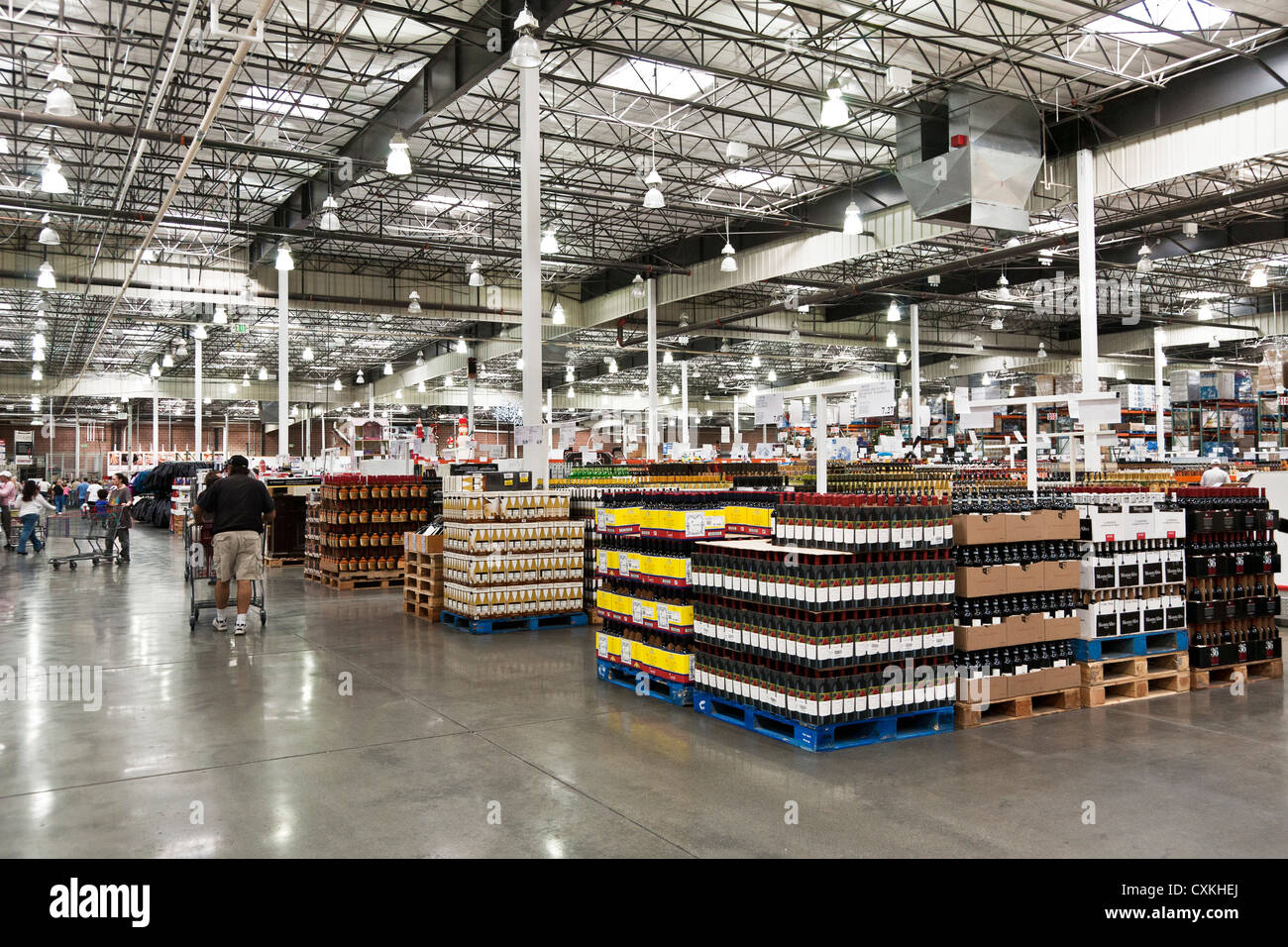 High Quality Customer Members Browse Wide Aisles Of Liquor Area In Vast Interior Space  Of Costco Big Box Warehouse Chain Retailer USA
