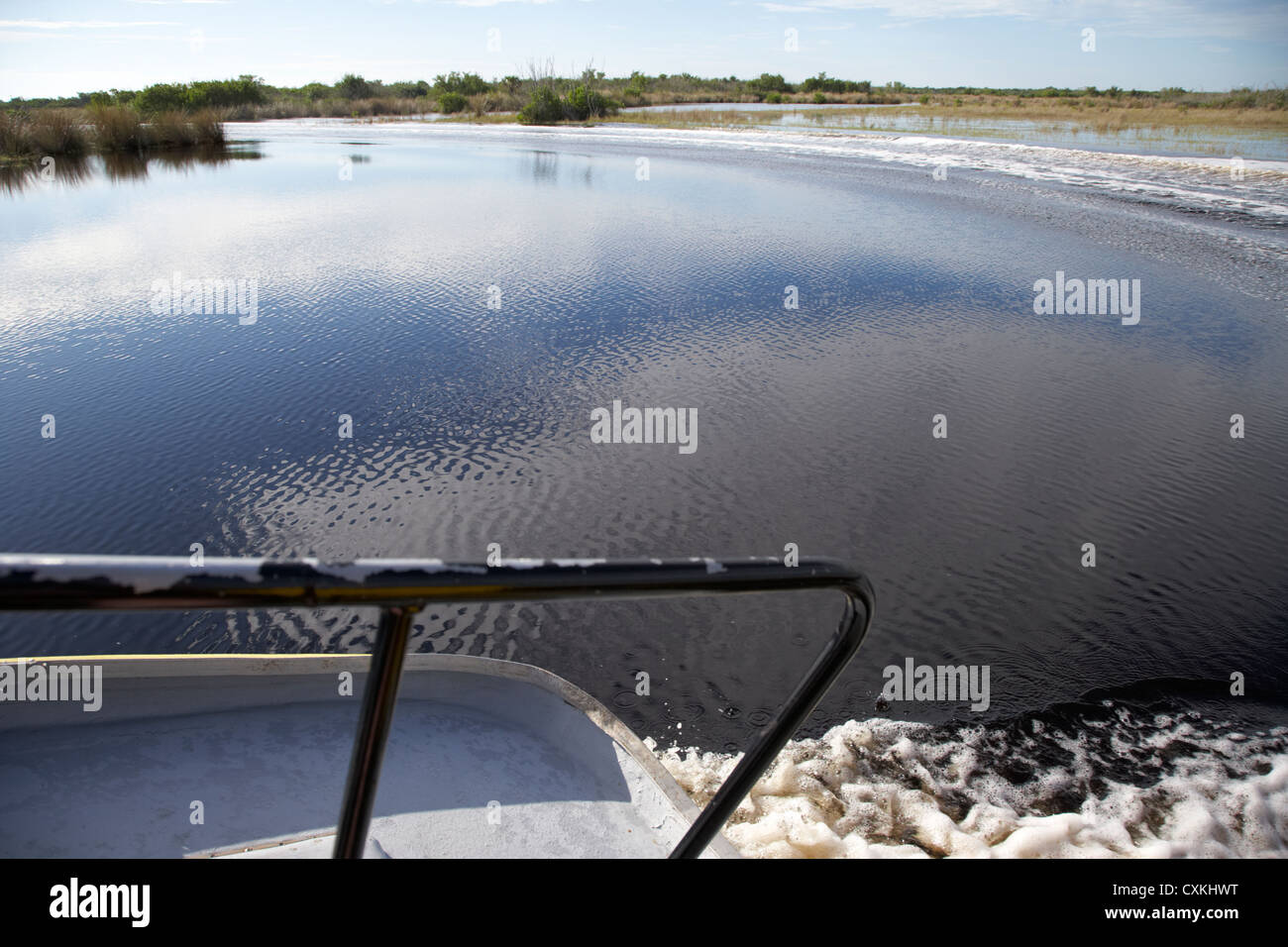 on board an airboat ride with boat wake in the grasslands everglades city florida everglades usa - Stock Image