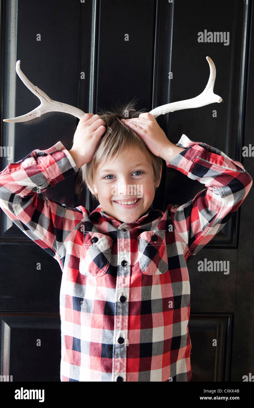 Young boy with antlers - Stock Image